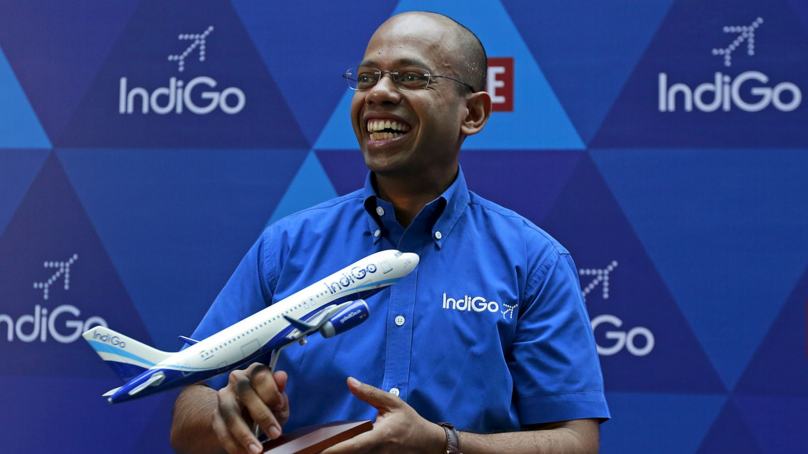 President of InterGlobe Aviation Limited Aditya Ghosh holds a memento during the company's listing ceremony at the National Stock Exchange (NSE) in Mumbai, India, November 10, 2015. The owner of IndiGo, India's biggest airline by market share, surged as much as 17.6 percent in its market debut on Tuesday despite a premium valuation, as investors bet on future profits in one of the world's fastest growing aviation markets.