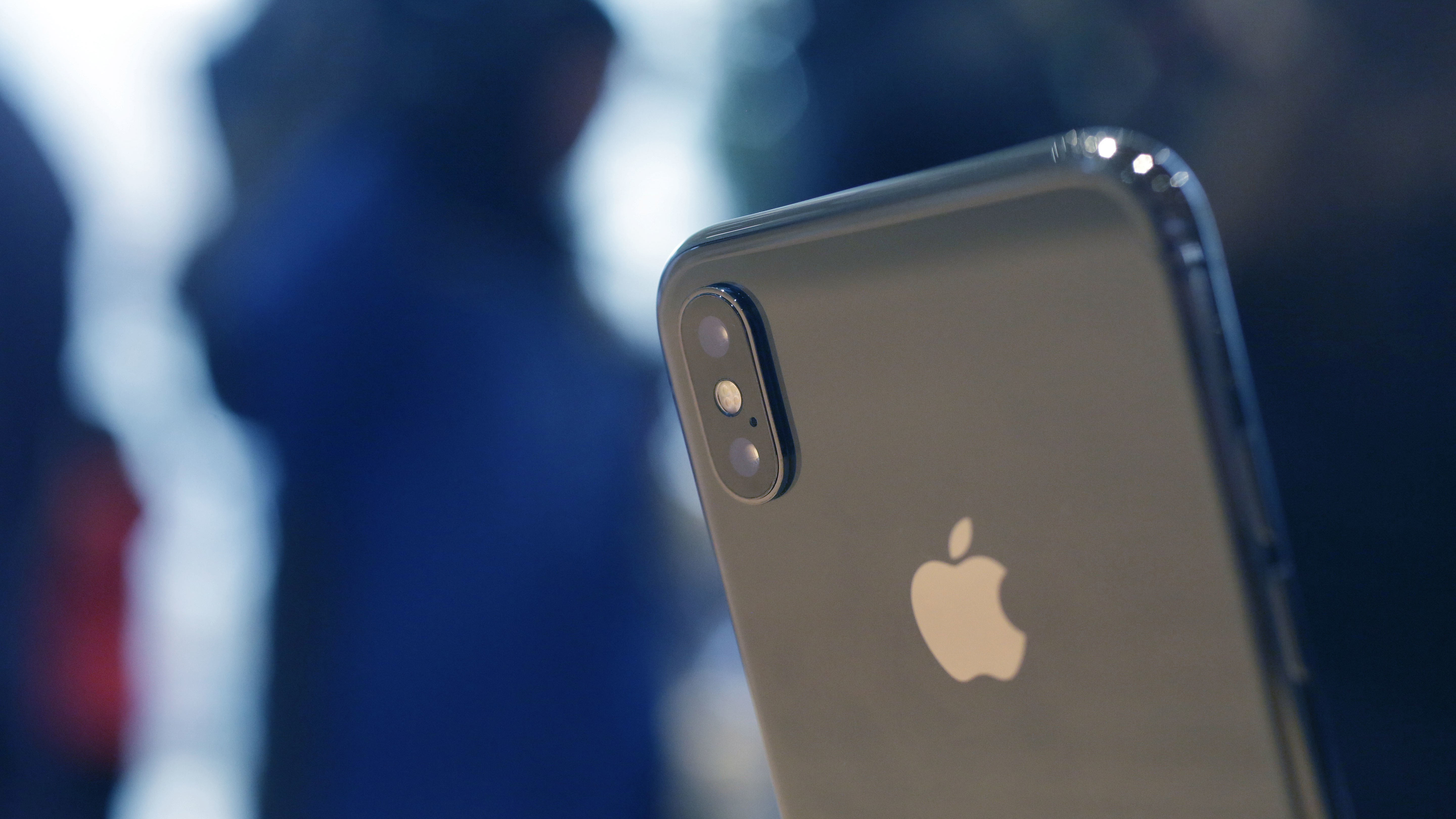 The Apple iPhone X sits on display at the new Apple Michigan Avenue store along the Chicago River Friday, Nov. 3, 2017, in Chicago. Apple launched its latests generation of the popular phone Friday. (AP Photo/Charles Rex Arbogast)