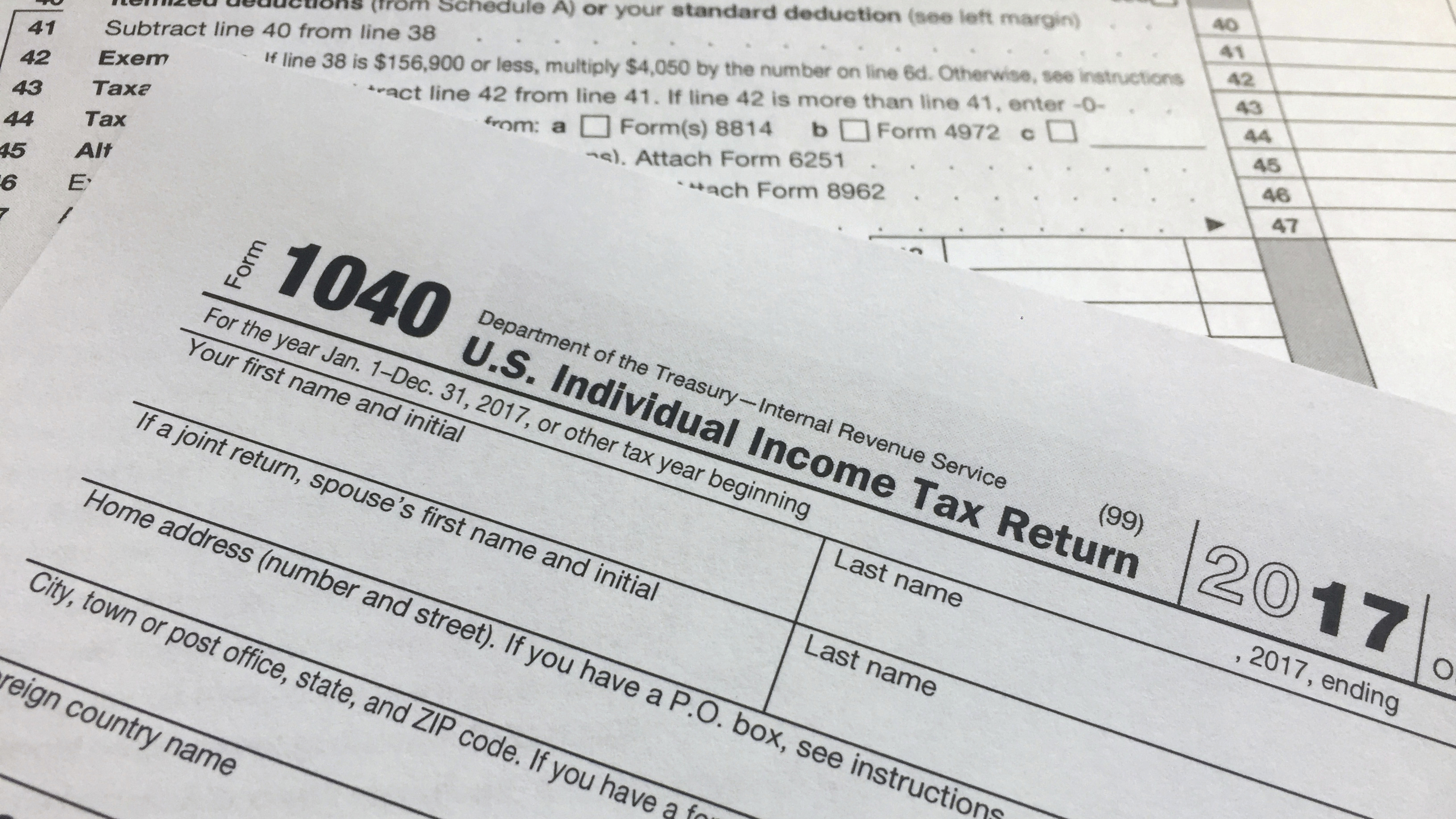 "An IRS 1040 form, U.S. Individual Income Tax Return, is shown on Thursday, April 5, 2018, in New York. Leading automated financial advisers — often called ""robo-advisers"" — such as Wealthfront and Betterment tout daily tax-loss harvesting as a way to significantly increase your returns. But independent research suggests the technique has less effect than claimed and may be more a gimmick than a true advantage for investors. (AP Photo/Jenny Kane)"