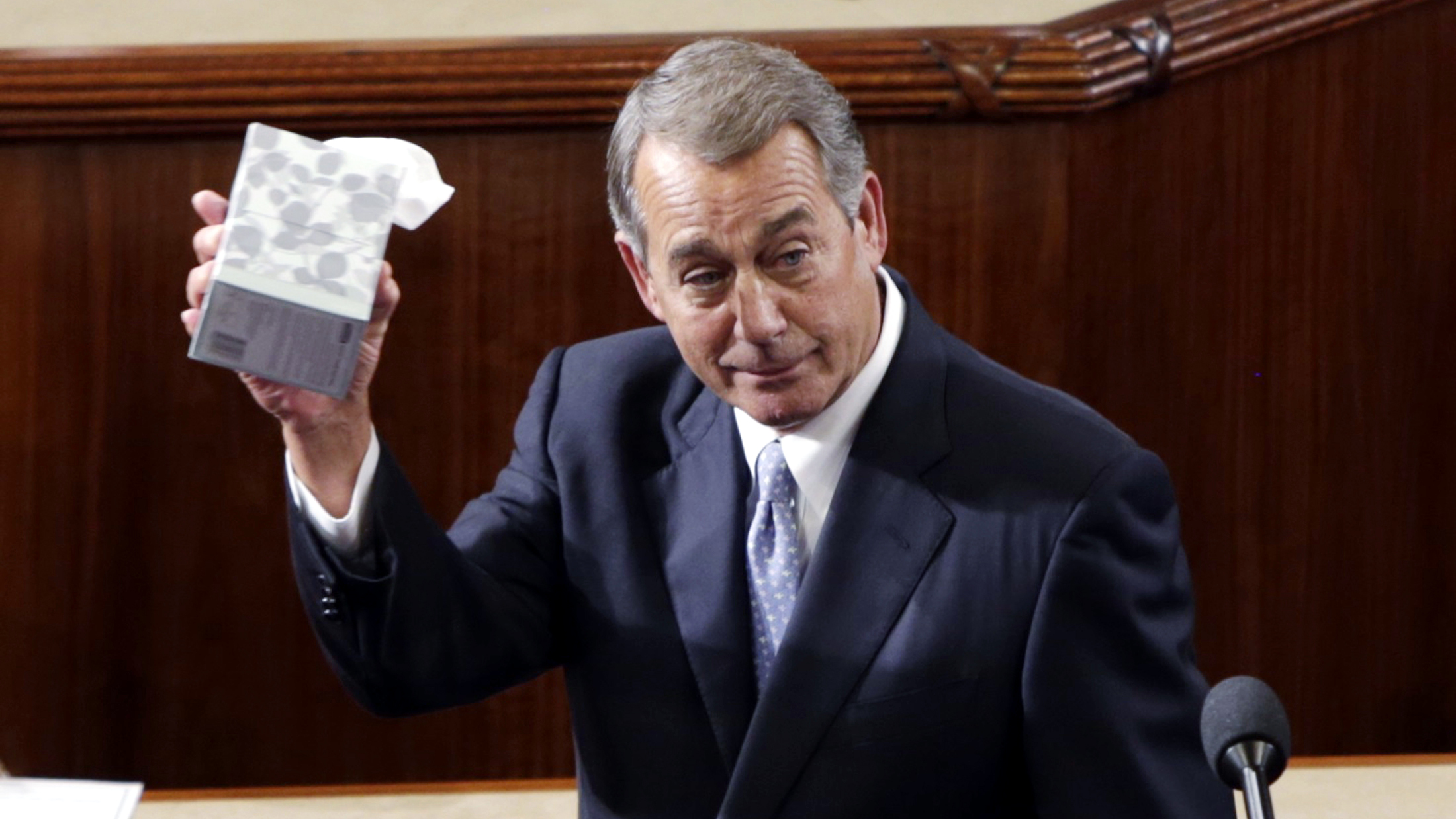 Outgoing House Speaker John Boehner (R-OH) waves his trademark box of tissues as he addresses colleagues prior to the election for the new Speaker of the U.S. House of Representatives on Capitol Hill in Washington October 29, 2015.