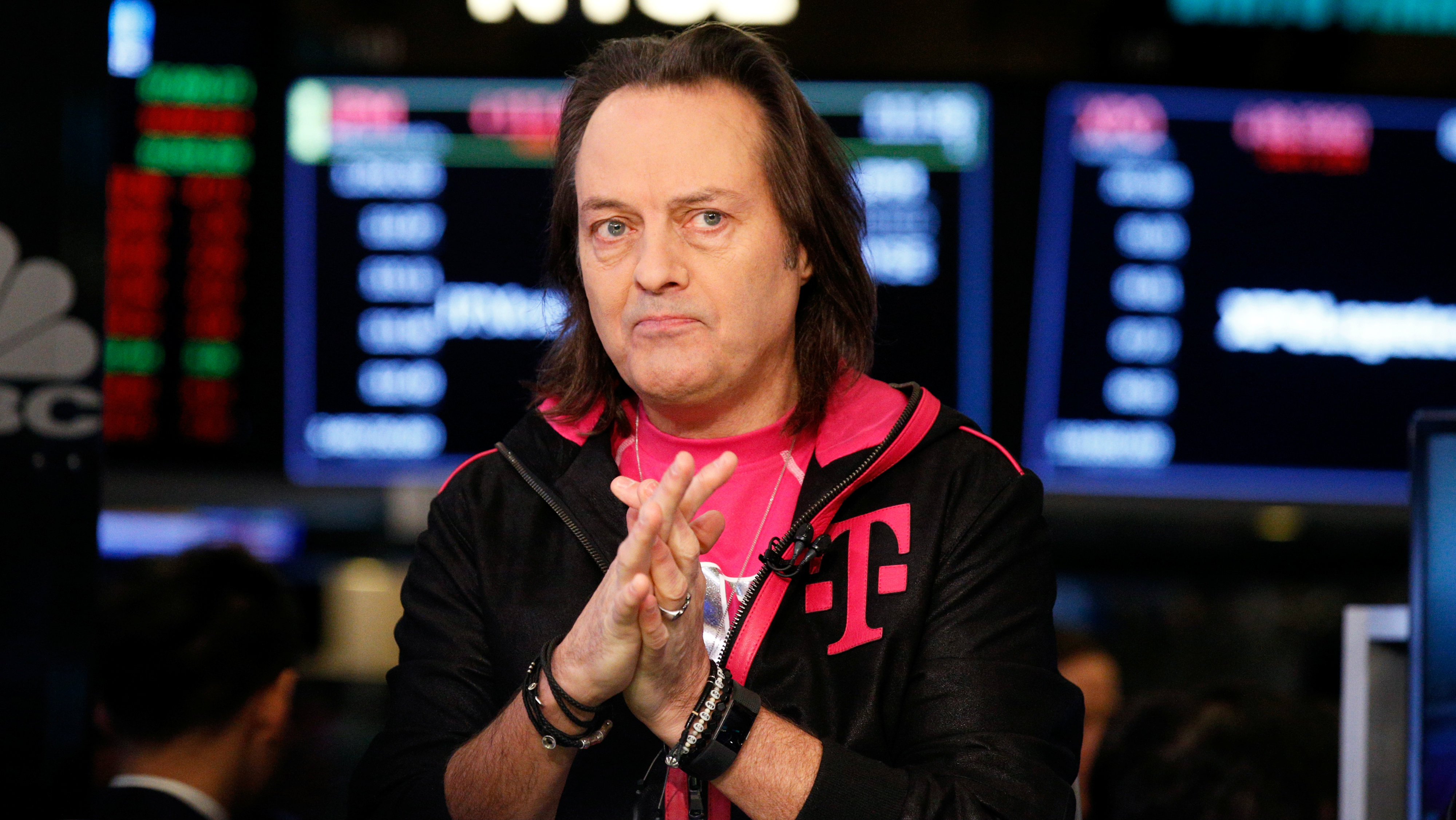 T-Mobile CEO John Legere prepares for an interview on the floor of the New York Stock Exchange in New York