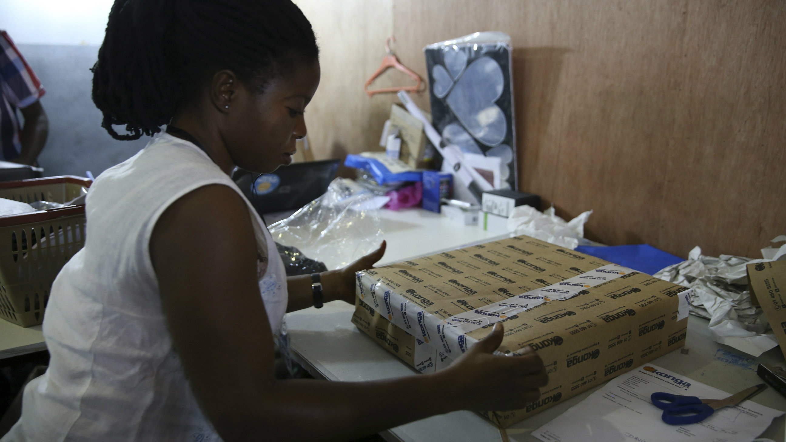 A staff prepares a good for delivery at the warehouse of Konga online shopping company in Ilupeju district in Nigeria's commercial capital Lagos September 13, 2013.
