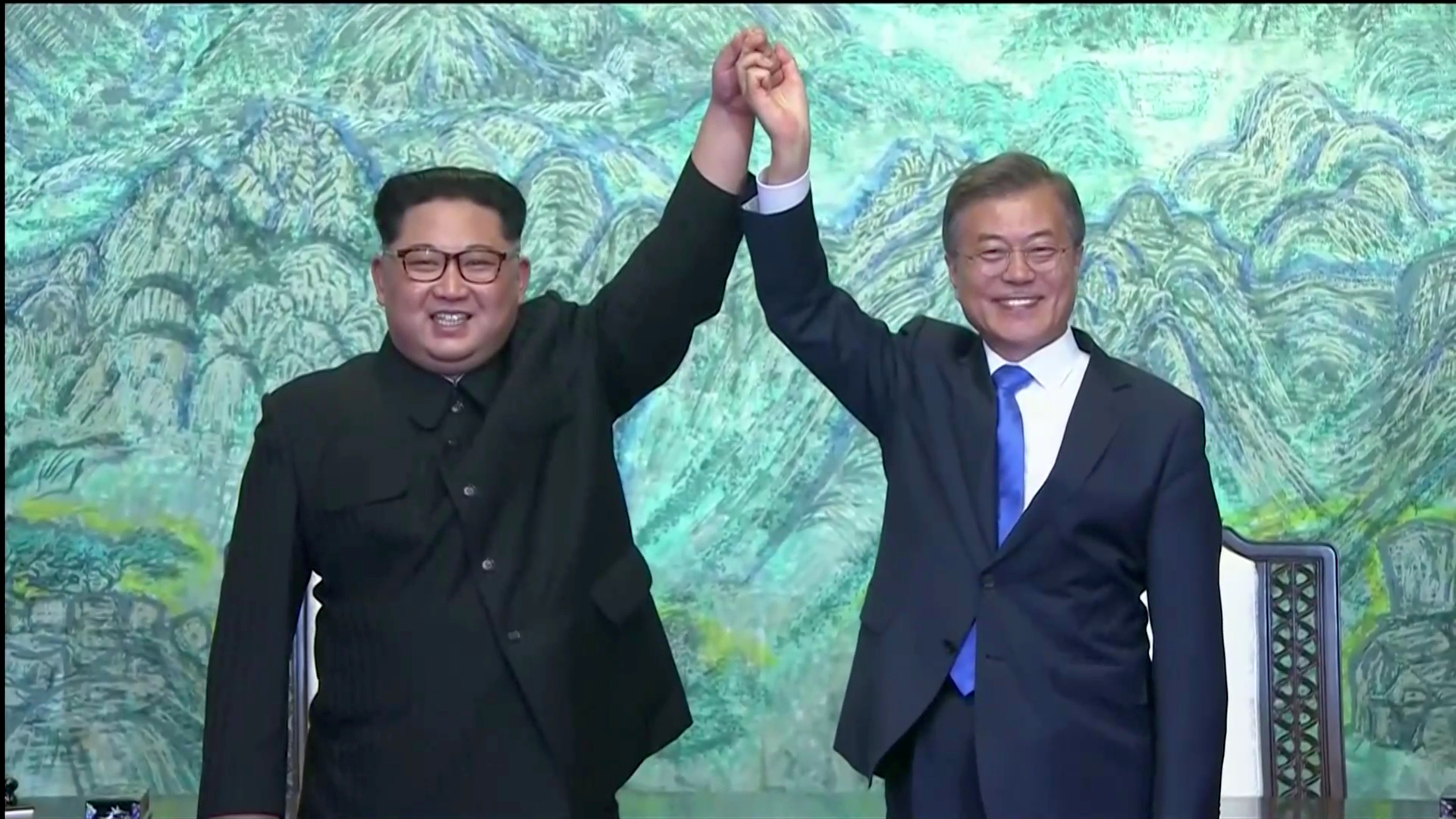 South Korean President Moon Jae-in and North Korean leader Kim Jong Un gesture after signing agreements during the inter-Korean summit at the truce village of Panmunjom, in this still frame taken from video, South Korea April 27, 2018. Host Broadcaster via REUTERS TV  ATTENTION EDITORS - THIS IMAGE HAS BEEN PROVIDED BY A THIRD PARTY. NO RESALES. NO ARCHIVES. SOUTH KOREA OUT. - RC14BC77FA20
