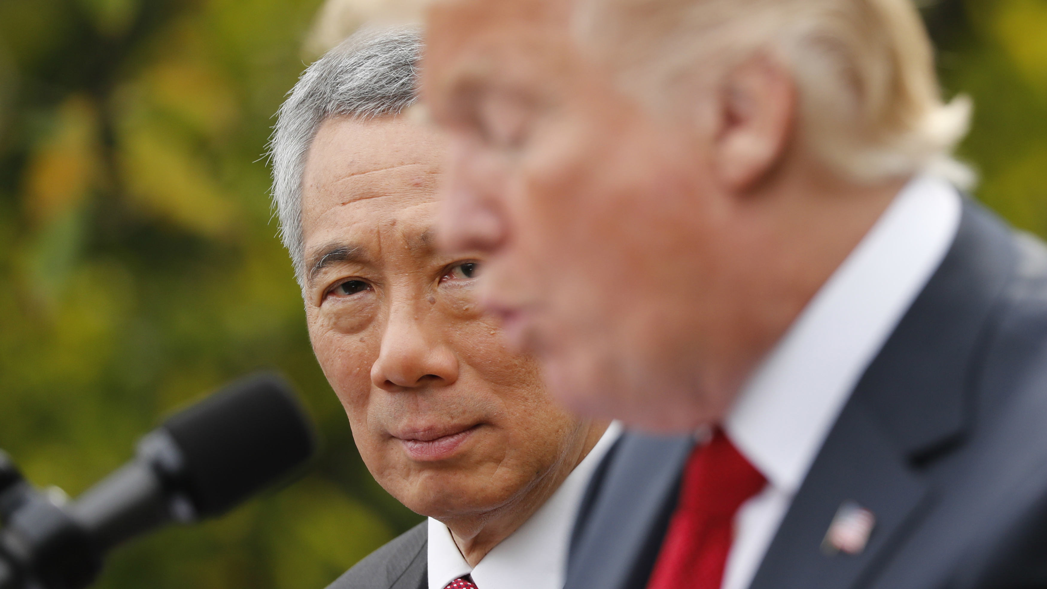Singapore's Prime Minister Lee Hsien Loong and U.S. President Donald Trump give joint statements in the Rose Garden of the White House in Washington, U.S., October 23, 2017.