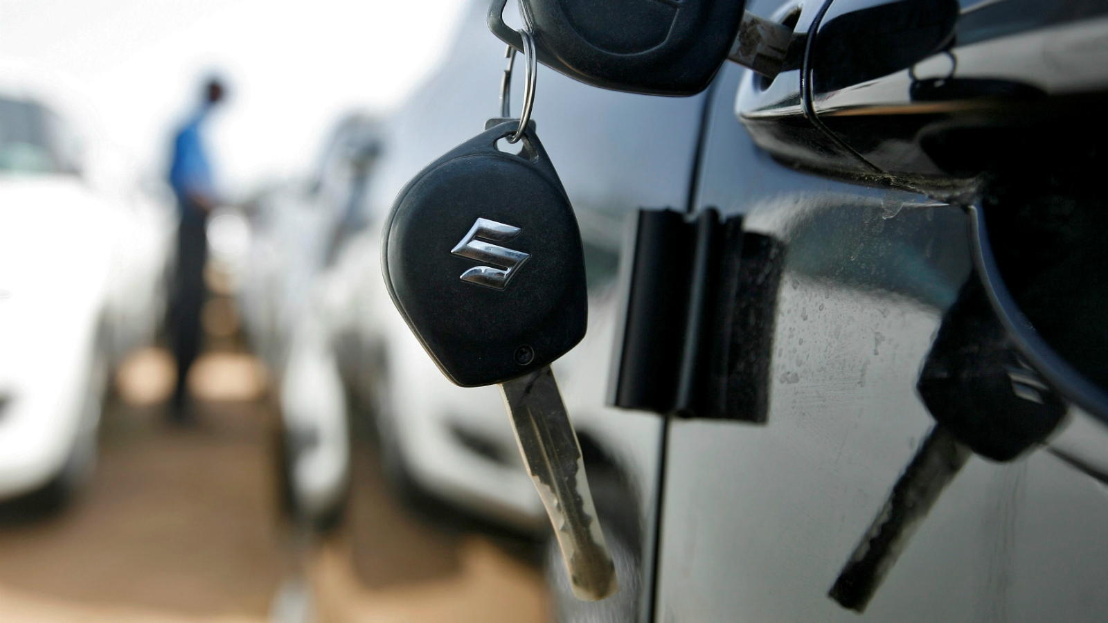 Keys hang from the door of a Maruti Suzuki Swift car at its stockyard on the outskirts of the western Indian city of Ahmedabad.