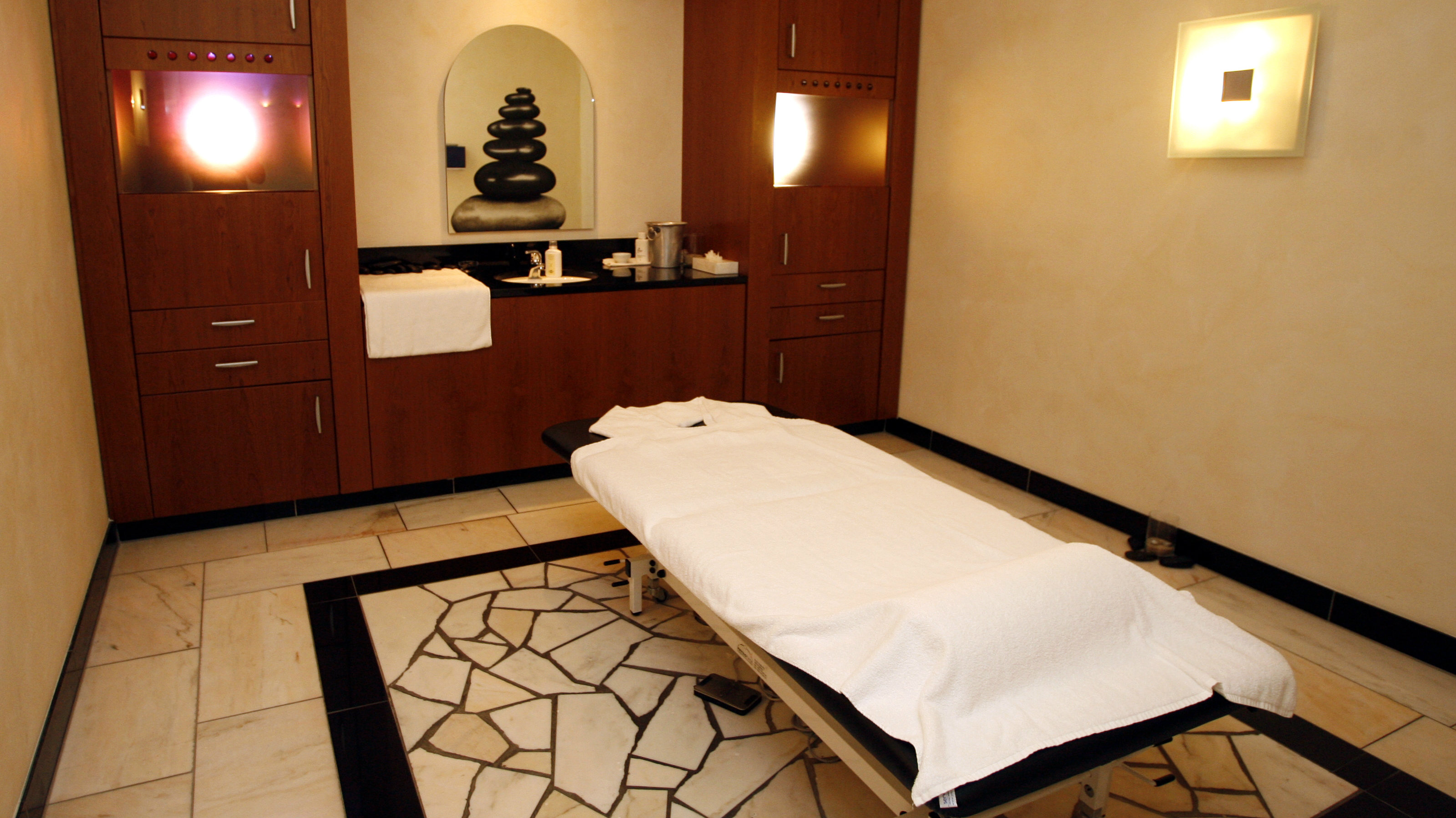 An interior view shows a massage bench in the wellness area of a hotel.