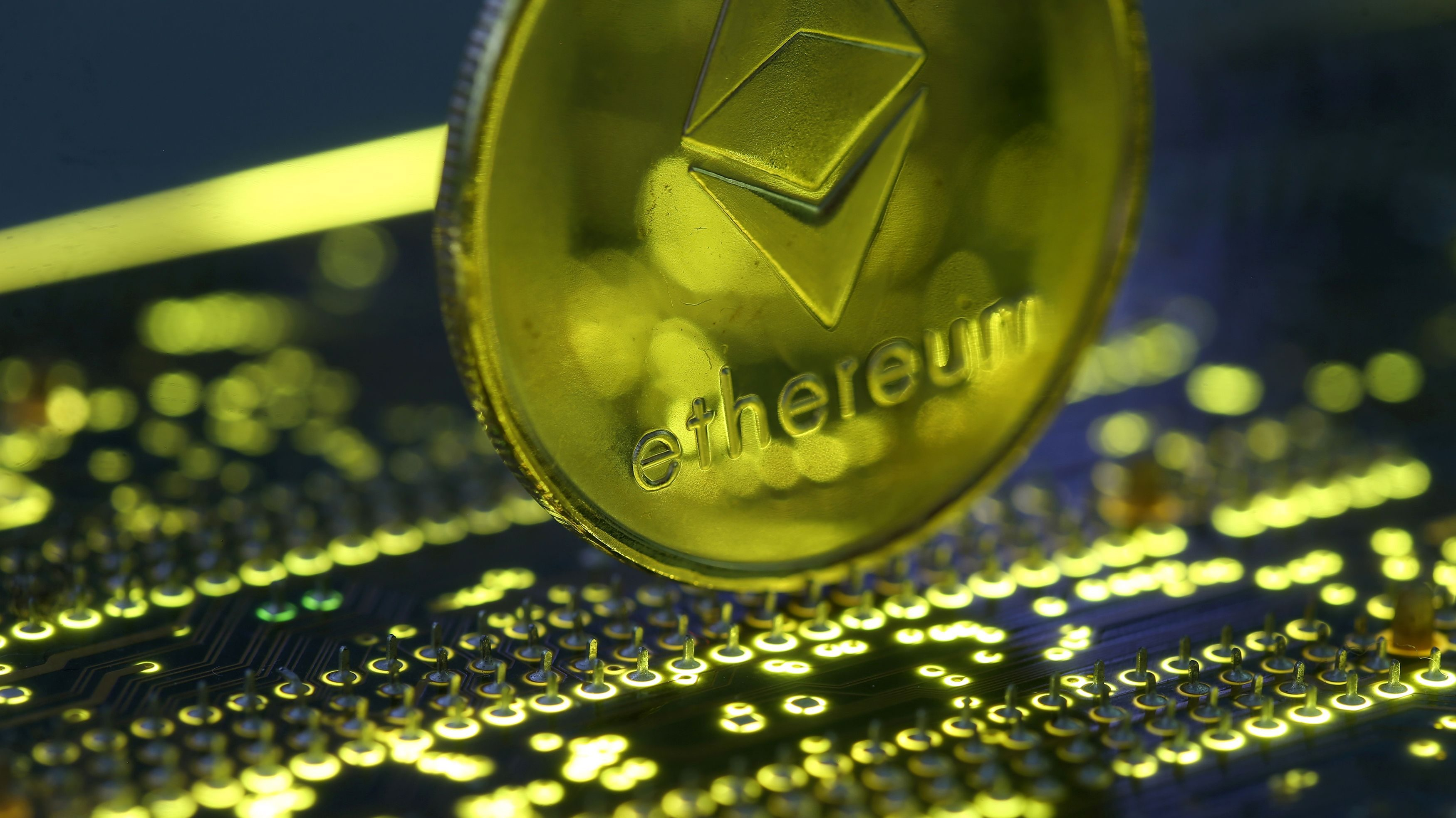 Representation of the Ethereum virtual currency standing on the PC motherboard is seen in this illustration picture, February 3, 2018.