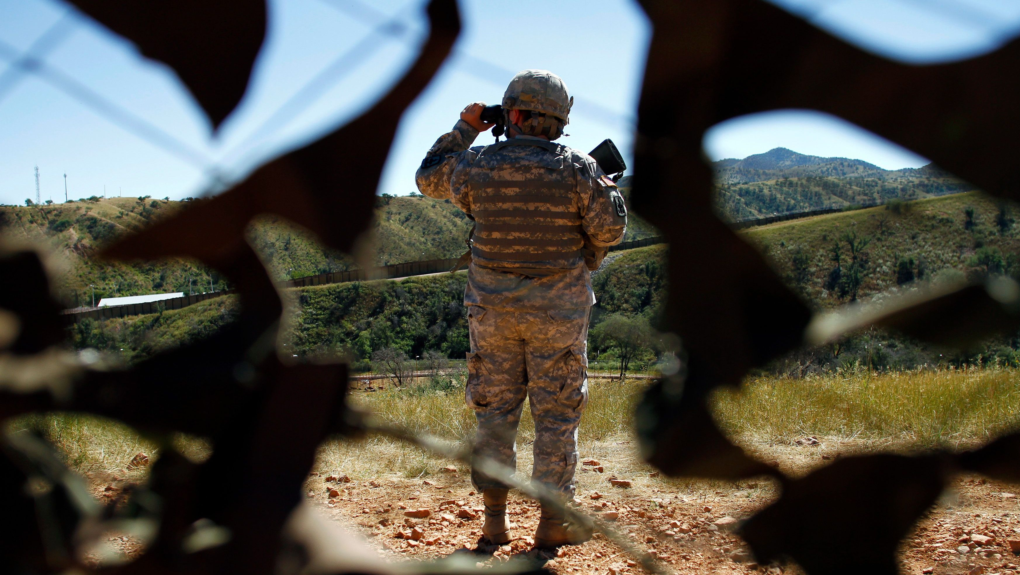 A member of the United States National Guard patrols along the U.S. and Mexico border in Nogales, Arizona in 2010.