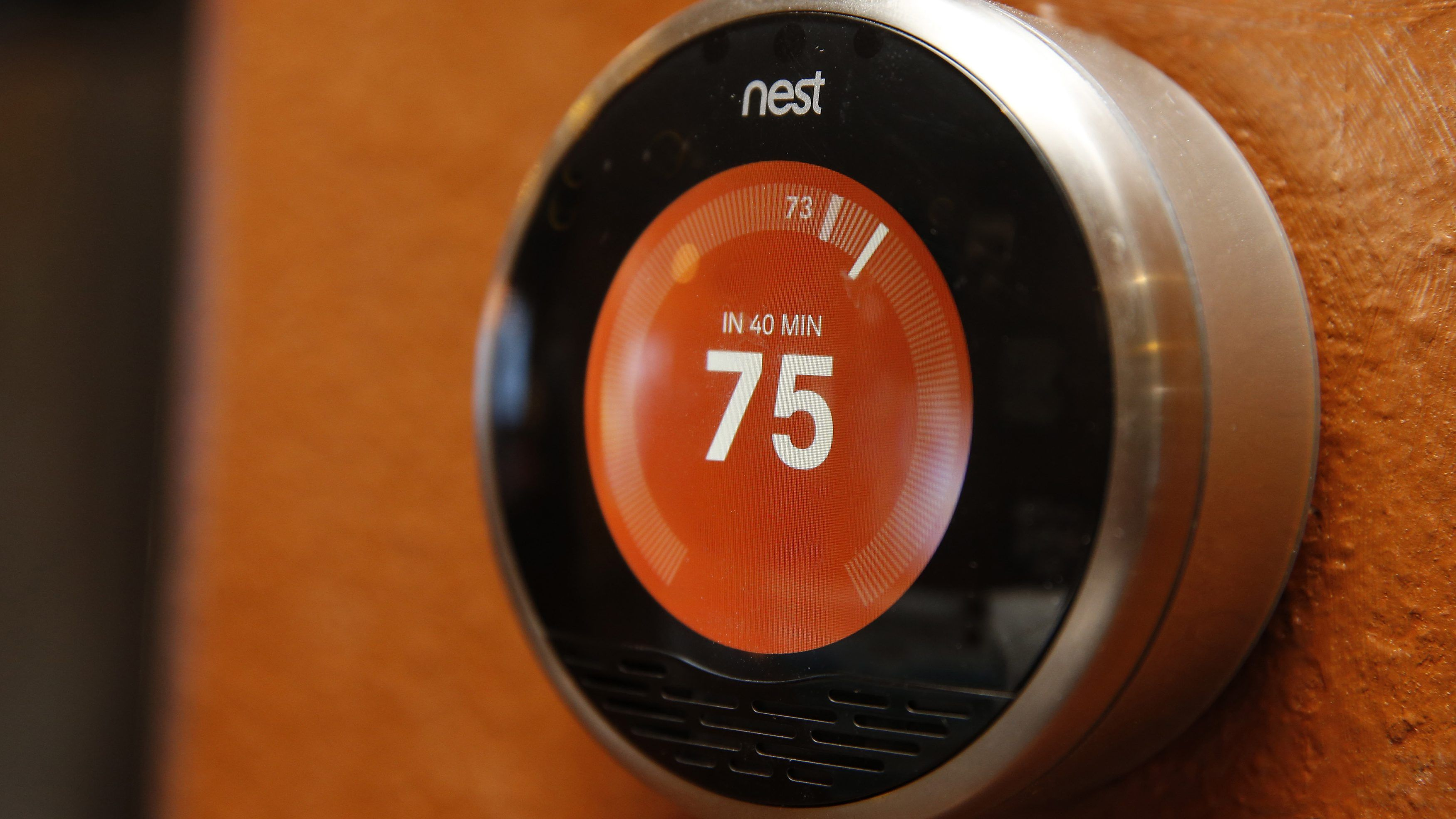 """A Nest thermostat is installed in a home in Provo, Utah, January 15, 2014. Google Inc took its biggest step to go deeper into consumers' homes, announcing a $3.2 billion deal January 13, 2014 to buy smart thermostat and smoke alarm-maker Nest Labs Inc, scooping up a promising line of products and a prized design team led by the """"godfather"""" of the iPod.  REUTERS/George Frey  (UNITED STATES - Tags: BUSINESS SCIENCE TECHNOLOGY) - TM4EA1F132U01"""