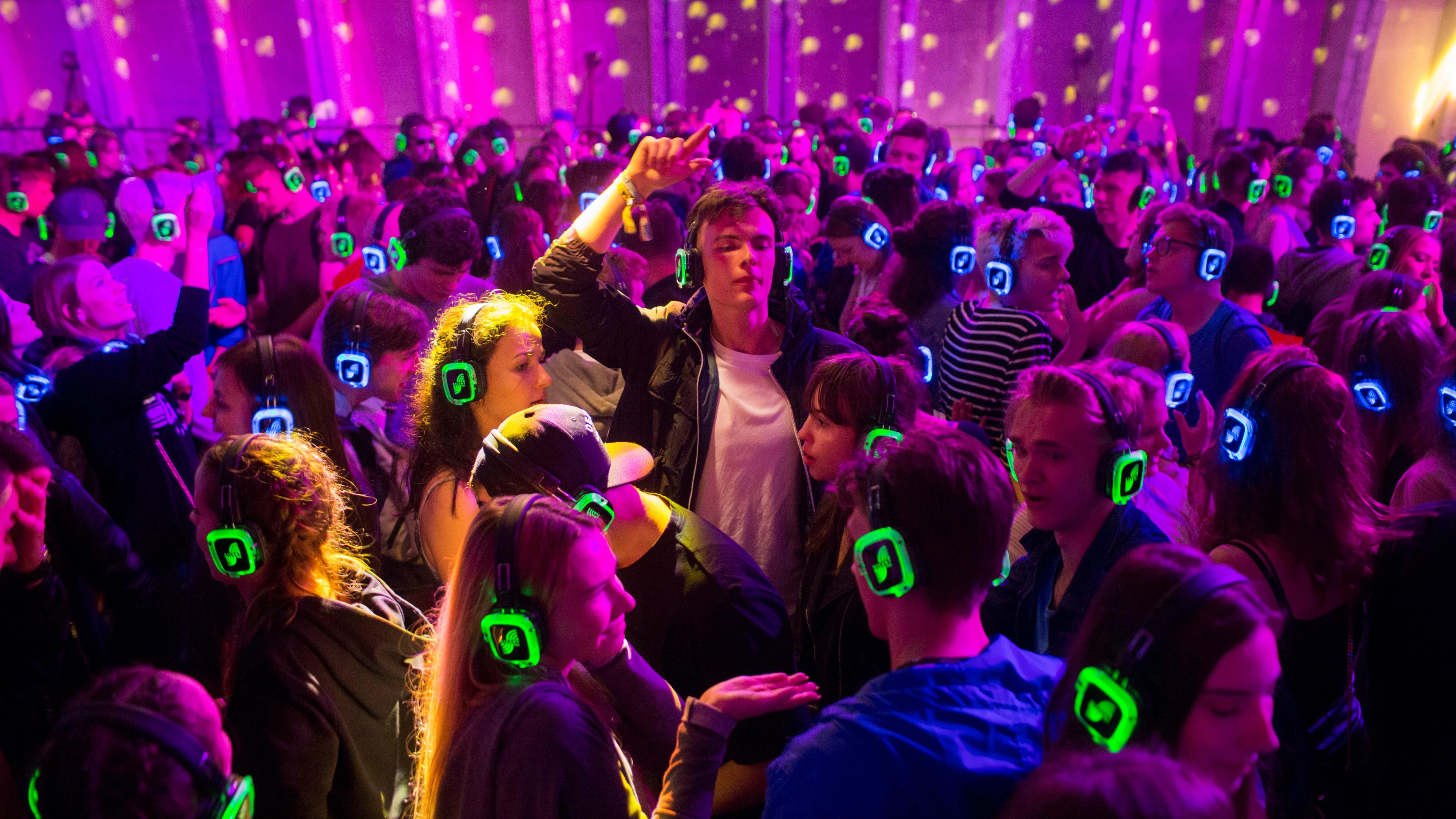 People dancing as part as silent disco