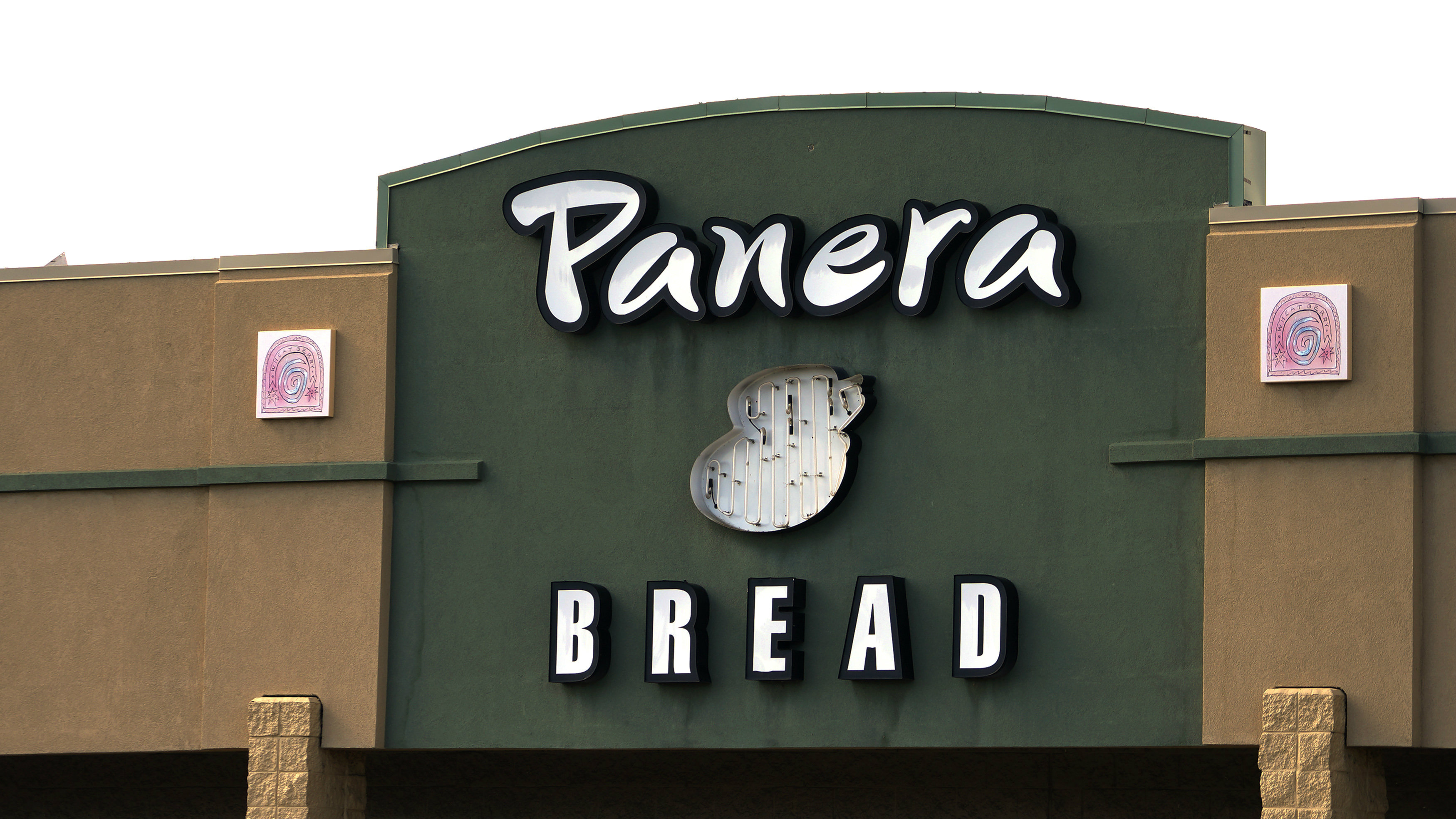 The sign on the hood of a delivery truck for Panera Bread Co. is seen in Westminster, Colorado