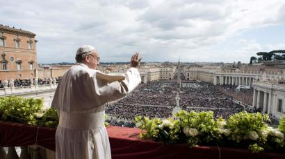 Pope Francis appears before delivering his Easter message in the Urbi et Orbi (to the City and the World) address from the balcony overlooking St. Peter's Square