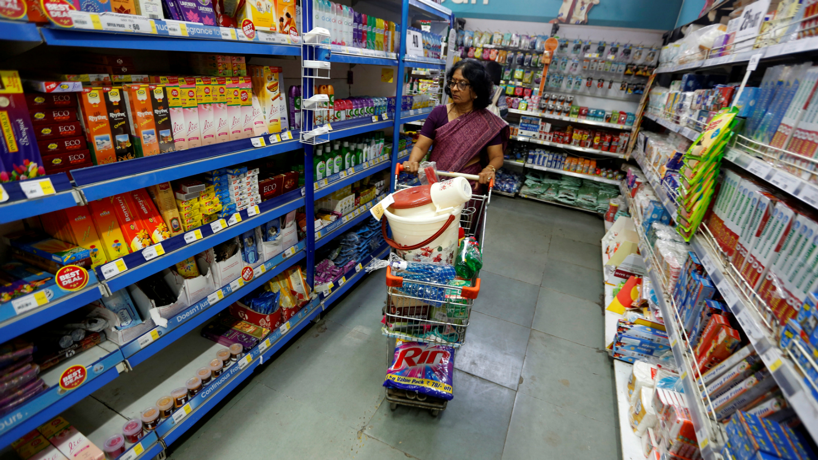 A woman wheels a shopping trolley at a food superstore in Ahmedabad, India October 13, 2016.