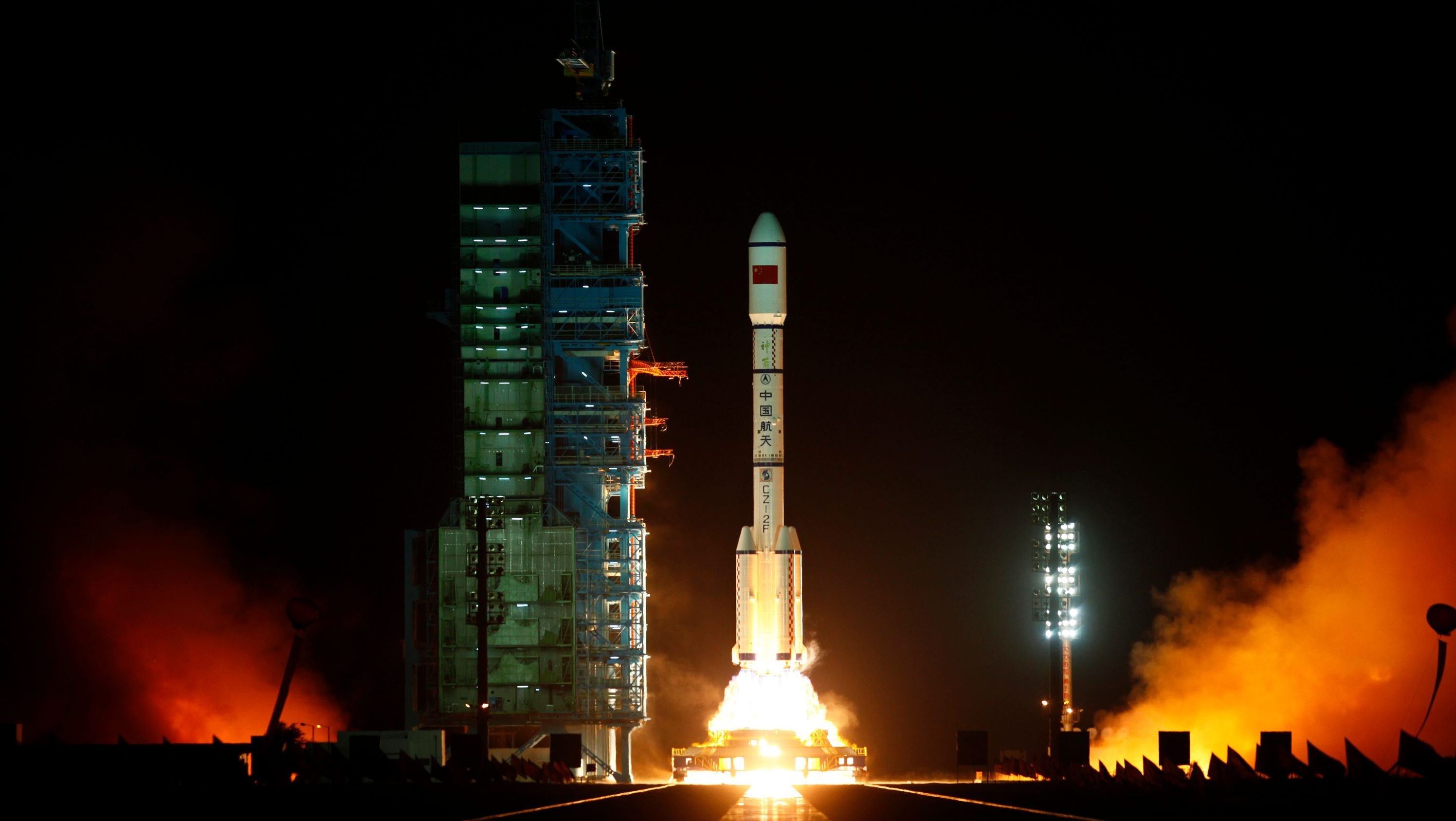 The Long March II-F rocket loaded with China's unmanned space module Tiangong-1 lifts off from the launch pad i