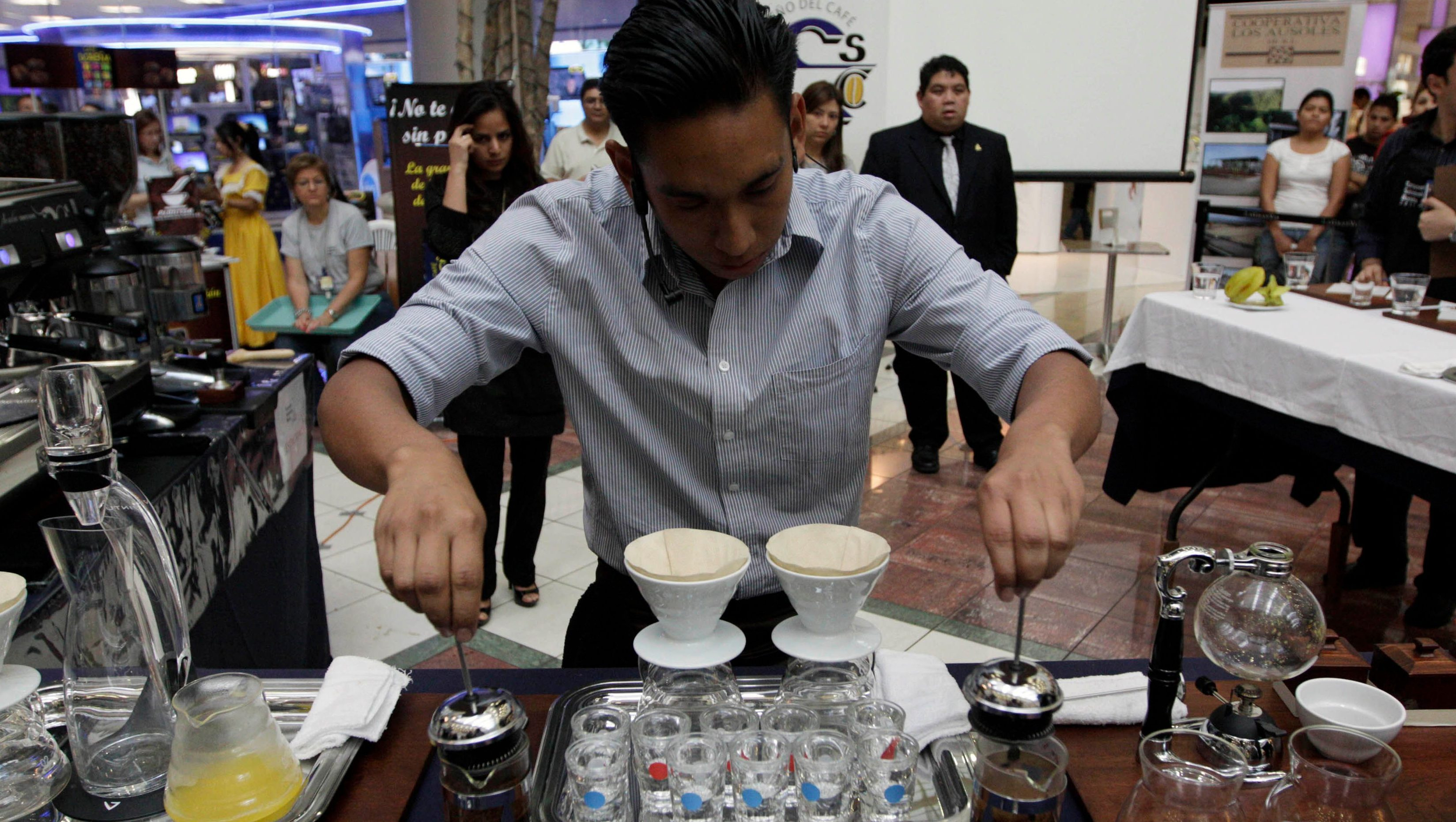 A competitor prepares coffee during the 4th El Salvador National Barista Championship at a mall in San Salvador February 19, 2011. The winner will represent El Salvador in the 2011 World Barista Championship, which will be held in June in Bogota, Colombia. REUTERS/Oscar Rivera (EL SALVADOR - Tags: FOOD SOCIETY) - GM1E72K0UQ801