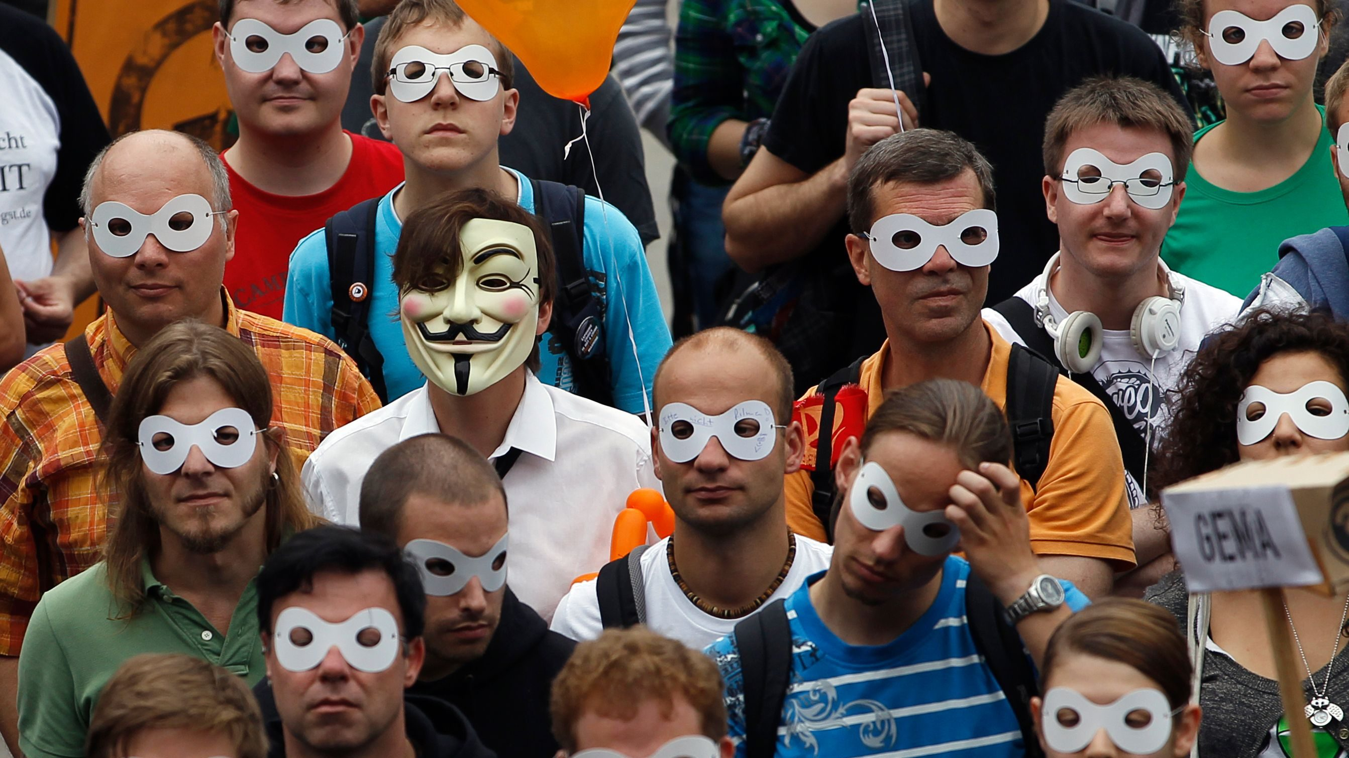 "People wear masks during the ""Freiheit Statt Angst"" (Freedom instead of Fear) protest calling for the protection of digital data privacy in Berlin, September 10, 2011.  The masks were handed out by the organisers who asked participants of the rally to wear them for the media to symbolise what call the individual's right to remain anonymous on the internet."