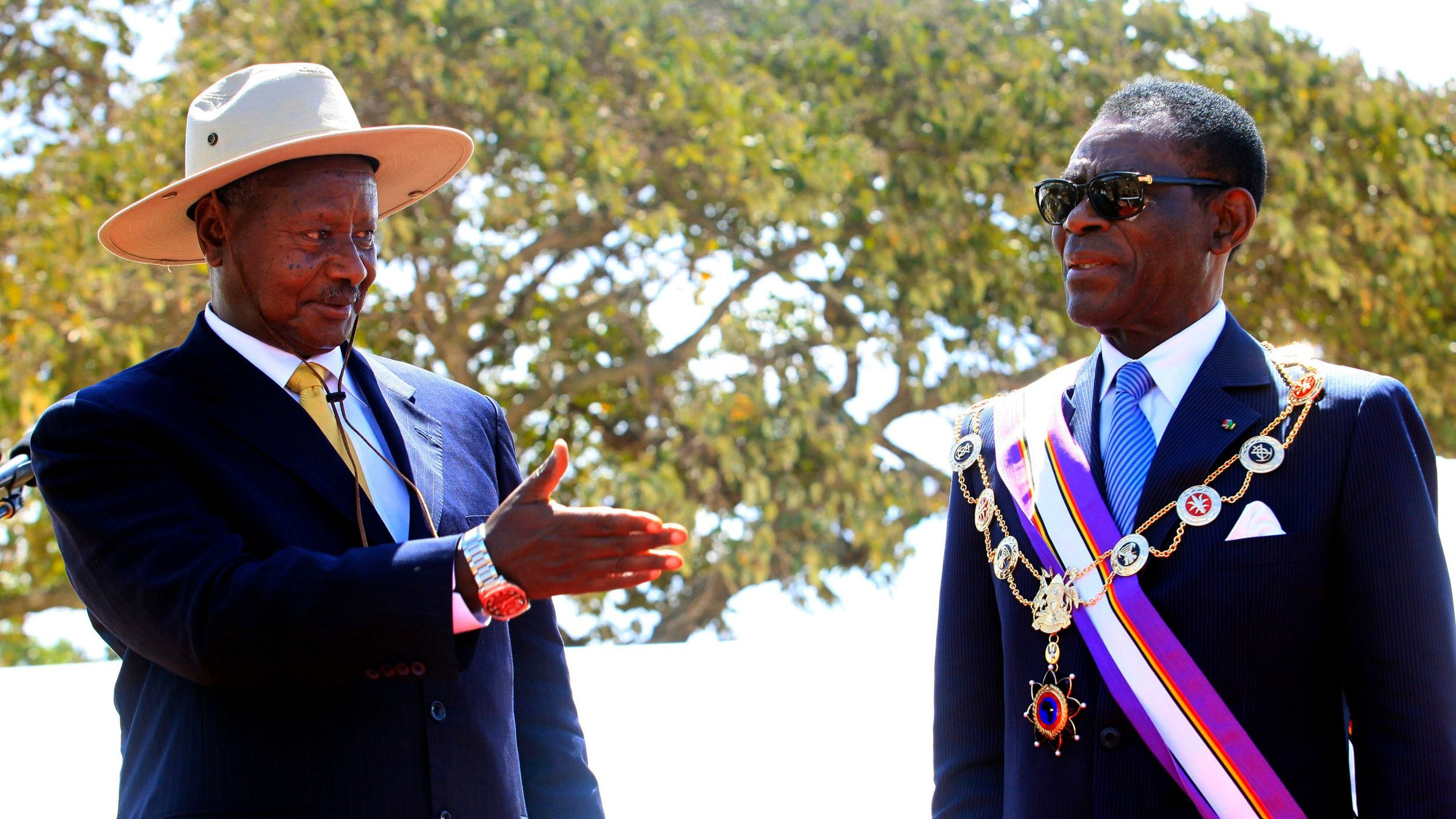 Uganda President Yoweri Museveni decorates his Equatorial Guinea counterpart Teodoro Obiang Nguema Mbasogo during the Pearl of Africa medal awards ceremony in Kapchorwa