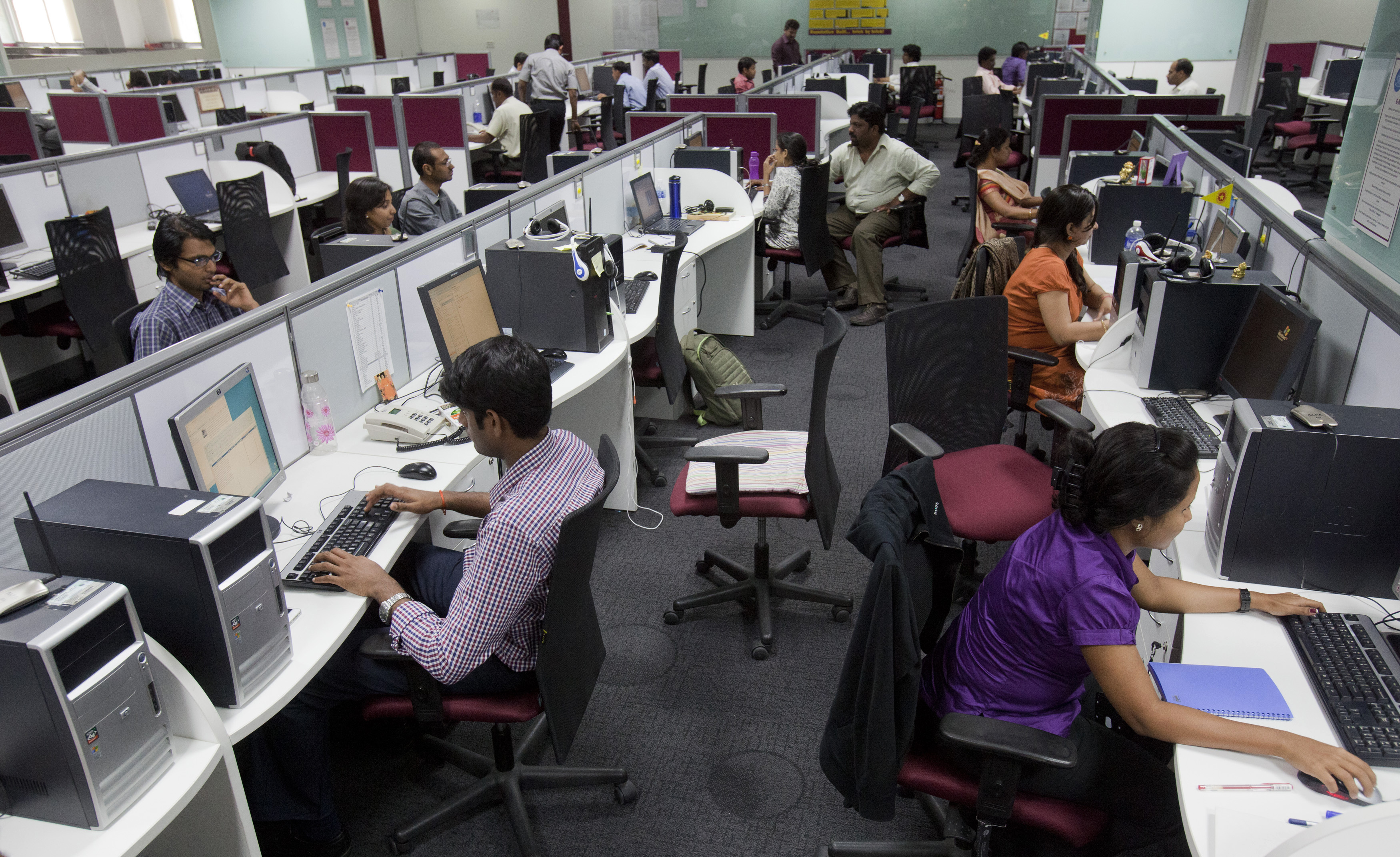 Workers are seen at their workstations on the floor of an outsourcing centre in Bangalore, February 29, 2012. India's IT industry, with Bangalore firms forming the largest component, is now worth an annual $100 billion and growing 14 percent per year, one of the few bright spots in an economy blighted by policy stagnation and political instability. Picture taken on February 29, 2012. To match Insight INDIA-OUTSOURCING/   REUTERS/Vivek Prakash (INDIA - Tags: BUSINESS EMPLOYMENT SCIENCE TECHNOLOGY) - GM1E8450SWY01