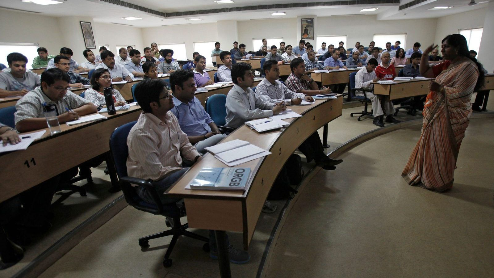 Master of Business Administration (MBA) students attend a lecture at a classroom at the Management Development Institute (MDI) in Gurgaon, on the outskirts of New Delhi May 2, 2012.  Fiscal constraints have increased the Indian government's reliance on private education institutes leading to a proliferation of private colleges like MDI. The number of management institutes has more than trebled to around 4000 in the last five years, of which at least two-thirds are estimated to be private colleges.    Picture taken May 2, 2012.       REUTERS/Adnan Abidi (INDIA - Tags: EDUCATION SOCIETY)  ATTENTION EDITORS: PICTURE 8 OF 22 FOR PACKAGE  'INDIA'S EDUCATION PRICE TAG' SEARCH 'GURGAON' FOR ALL IMAGES - GM1E87M15KW01