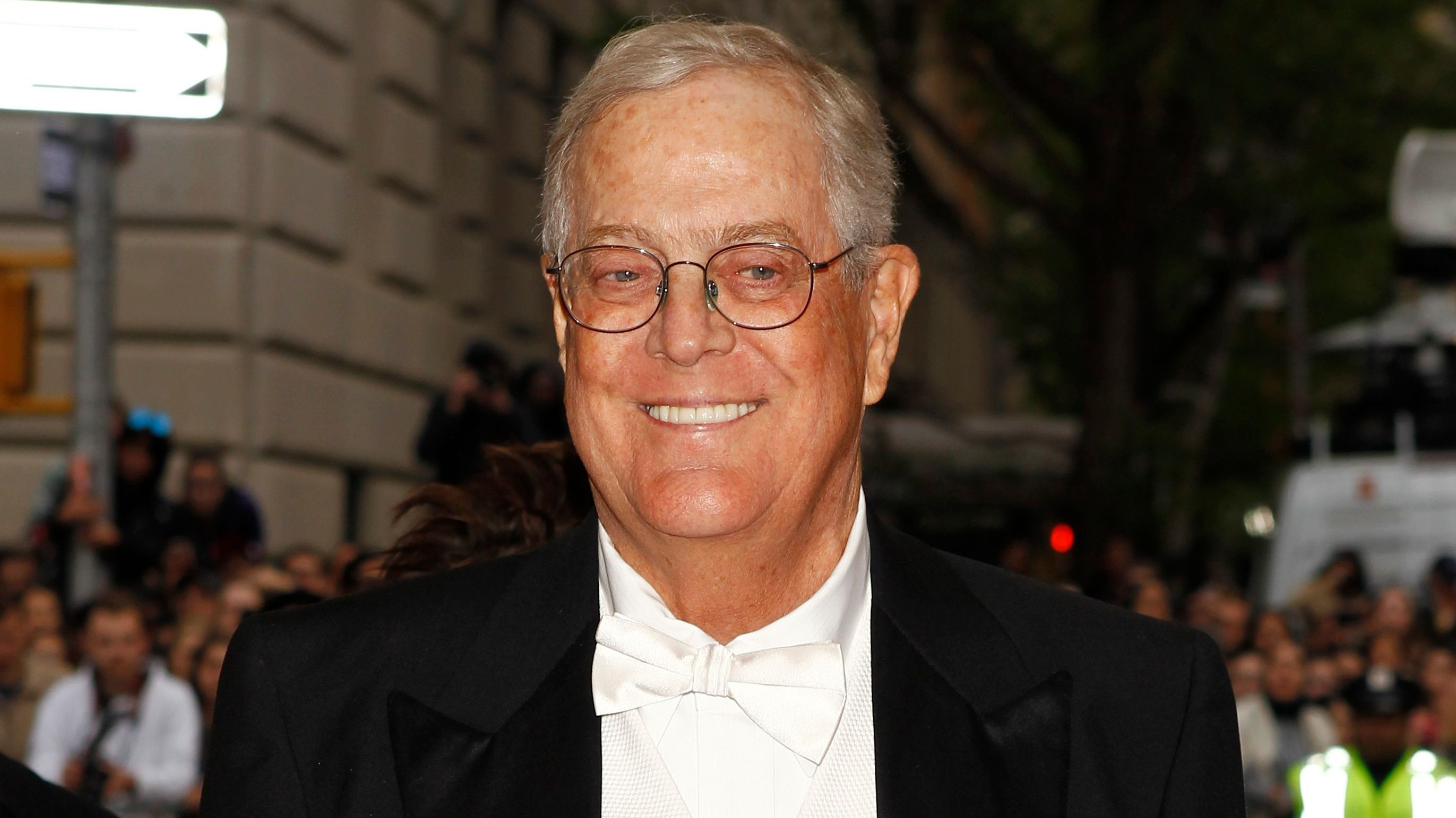 """Businessman David Koch arrives at the Metropolitan Museum of Art Costume Institute Gala Benefit celebrating the opening of """"Charles James: Beyond Fashion"""" in Upper Manhattan, New York May 5, 2014.  REUTERS/Carlo Allegri (UNITED STATES  - Tags: ENTERTAINMENT FASHION BUSINESS HEADSHOT)   - TB3EA5607U13C"""
