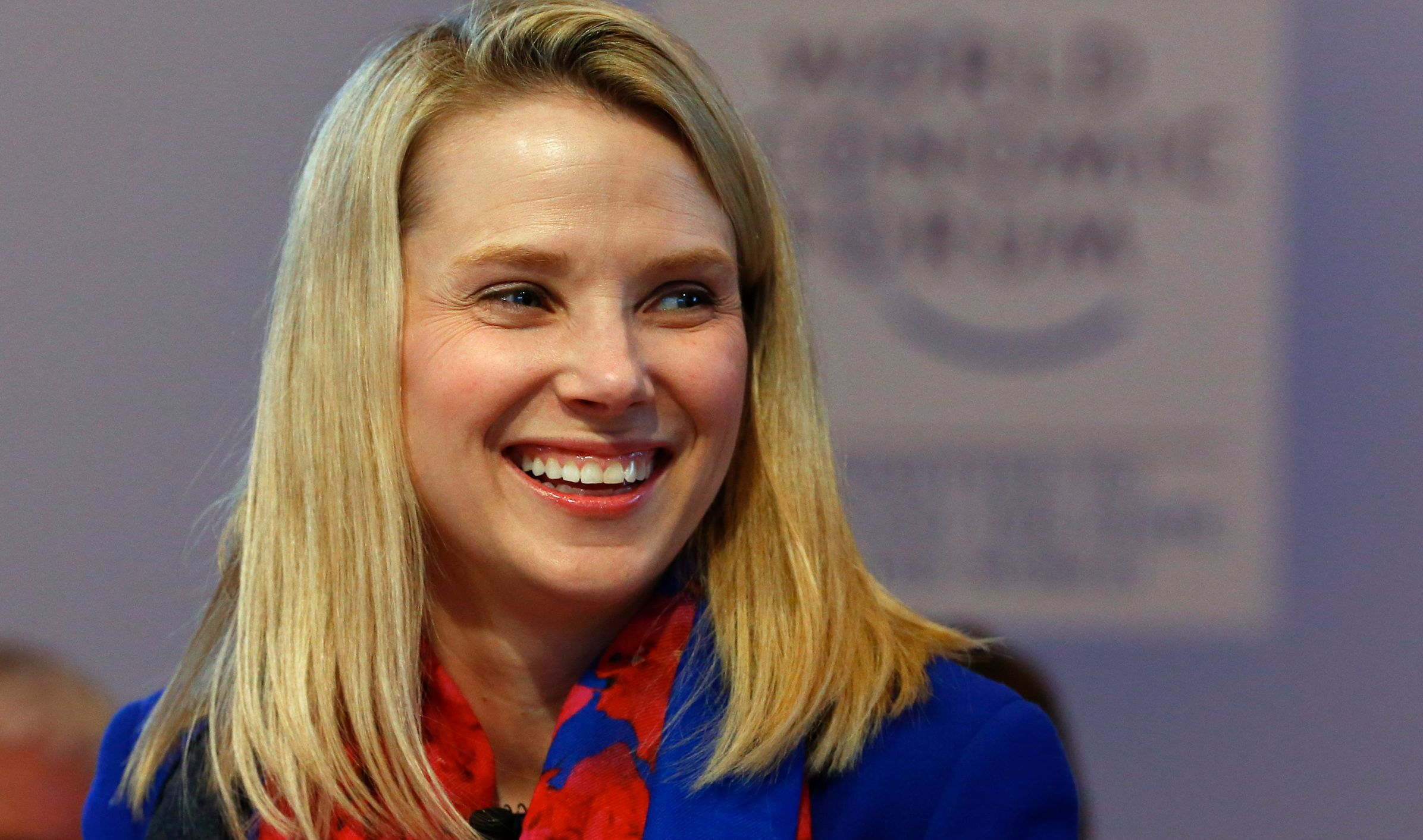"""Yahoo CEO Marissa Mayer smiles before the session """"In Tech We Trust"""" in the Swiss mountain resort of Davos January 22, 2015. More than 1,500 business leaders and 40 heads of state or government attend the Jan. 21-24 meeting of the World Economic Forum (WEF) to network and discuss big themes, from the price of oil to the future of the Internet. This year they are meeting in the midst of upheaval, with security forces on heightened alert after attacks in Paris, the European Central Bank considering a radical government bond-buying programme and the safe-haven Swiss franc rocketing.                                         REUTERS/Ruben Sprich (SWITZERLAND  - Tags: BUSINESS POLITICS)   - RTR4MHVI"""