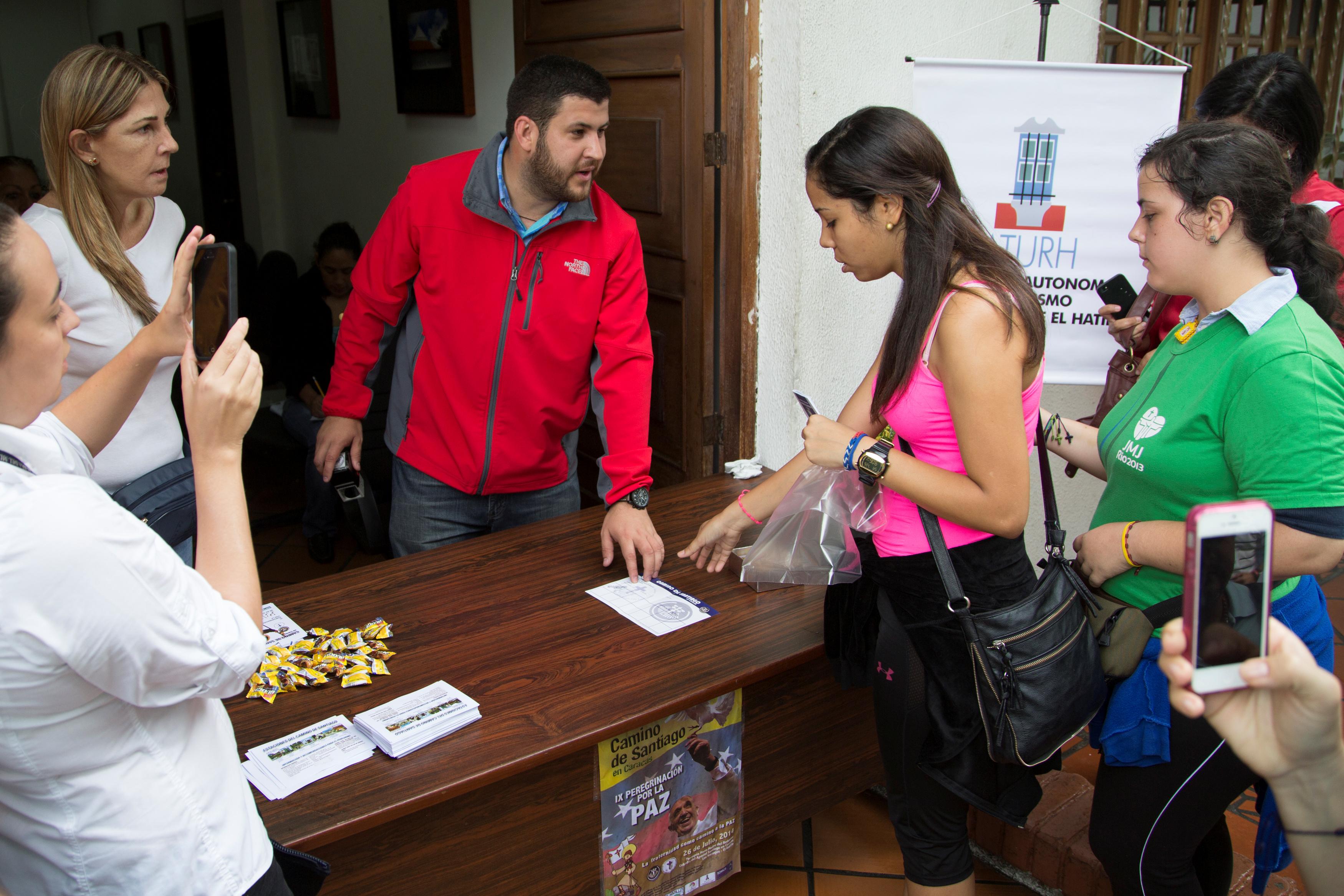 David Smolansky talks to a woman at El Hatillo town hall in Caracas in 2014.