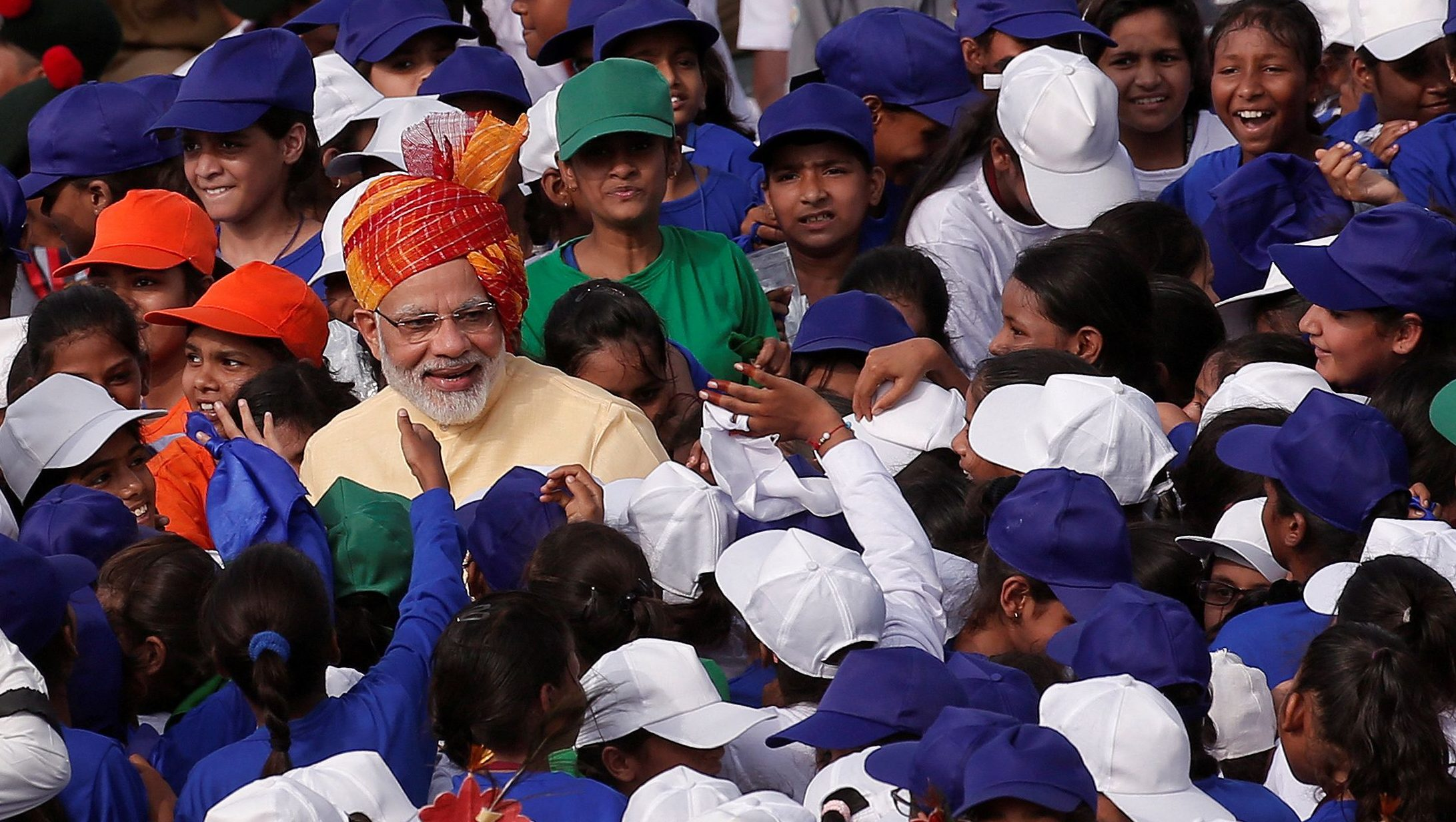 Indian Prime Minister Narendra Modi greets school children after addressing the nation from the historic Red Fort during Independence Day celebrations in Delhi, India August 15, 2017. REUTERS/Adnan Abidi     TPX IMAGES OF THE DAY - RC1124D0BC90