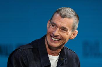 Chip Bergh, president & chief executive officer of Levi Strauss & Co., shows off a connected jacket as he speaks at the Wall Street Journal Digital conference in Laguna Beach, California, U.S., October 17, 2017. REUTERS/Mike Blake - RC1DFFEB08D0