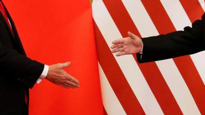 U.S. President Donald Trump and China's President Xi Jinping shakes hands after making joint statements at the Great Hall of the People in Beijing, China, November 9, 2017.