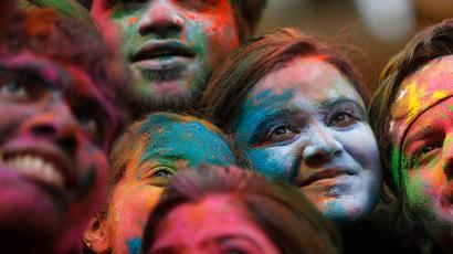 d934eb74cebbd9 People pose for a selfie while celebrating Holi in Mumbai. Reuters/Shailesh  Andrade. What colors do you see?