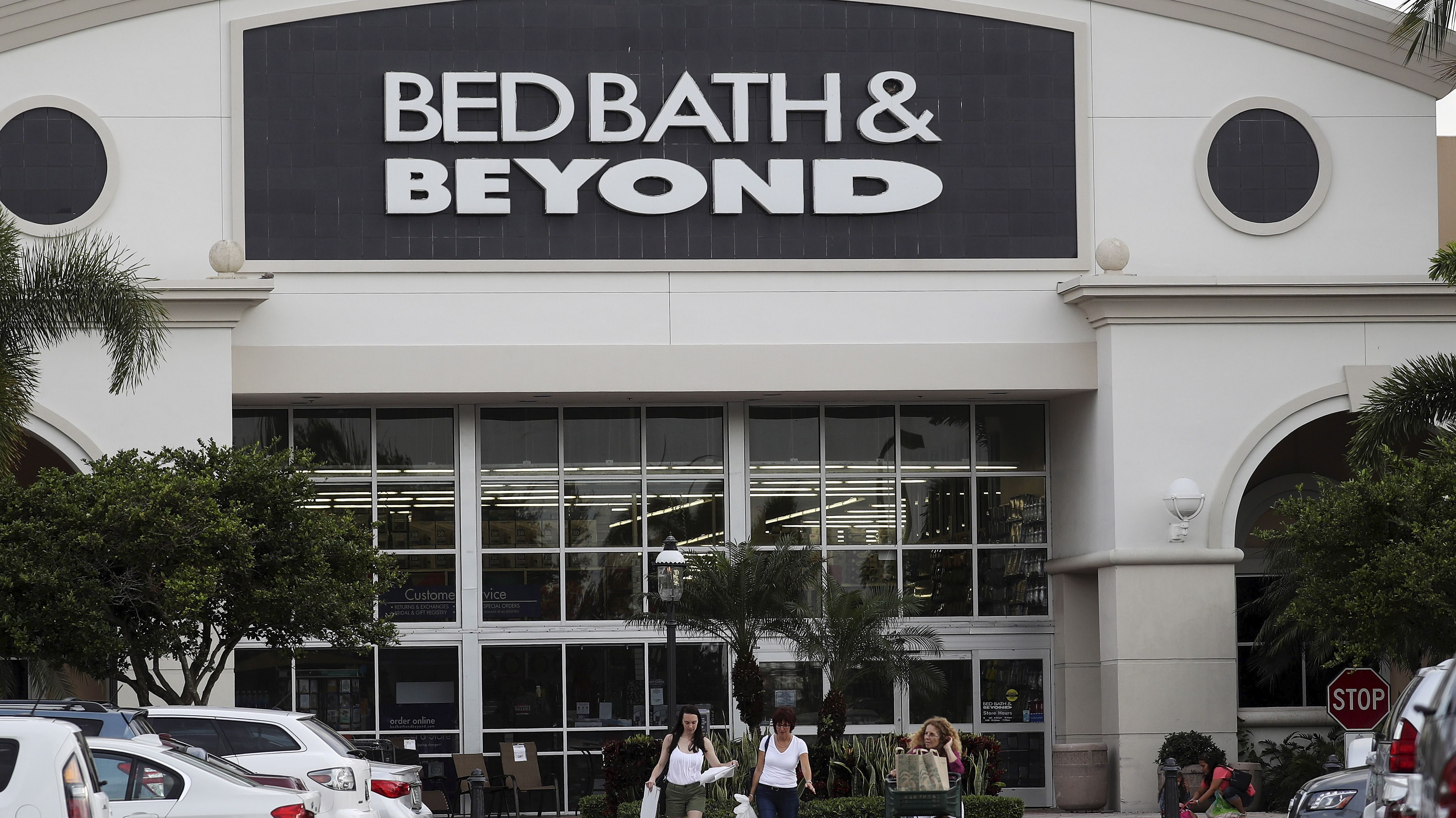 File photo of shoppers leaving a Bed Bath and Beyond store in Boca Raton