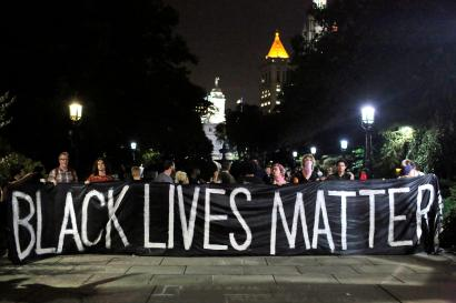 People hold up a banner during a Black Lives Matter protest outside City Hall in Manhattan, New York, U.S., August 1, 2016. REUTERS/Andrew Kelly - RTSKN2B