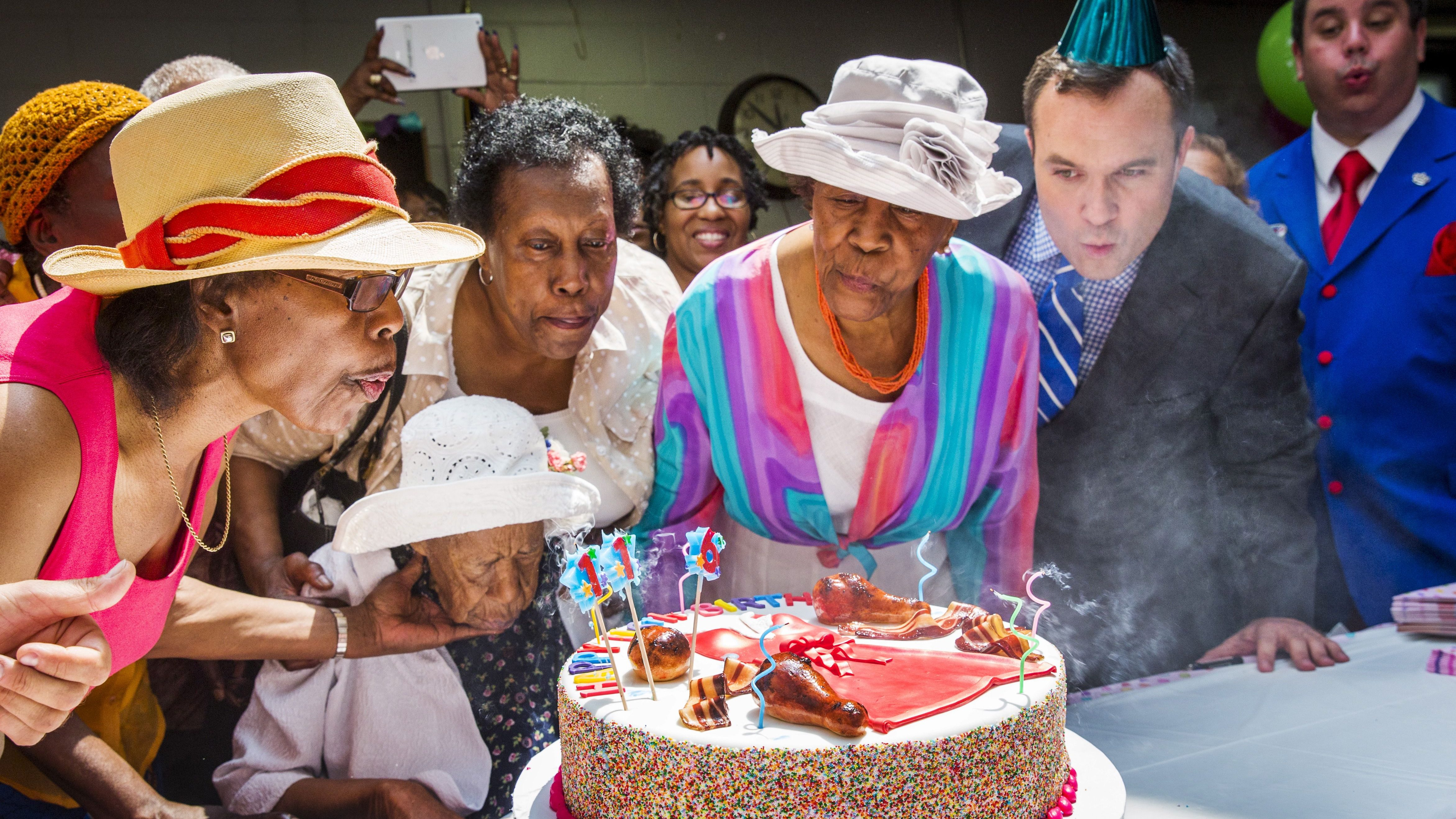 """Susannah Mushatt Jones (seated), known as """"Miss Susie"""" celebrates her 116th birthday with family members, local dignitaries, and friends in the Brooklyn borough of New York"""