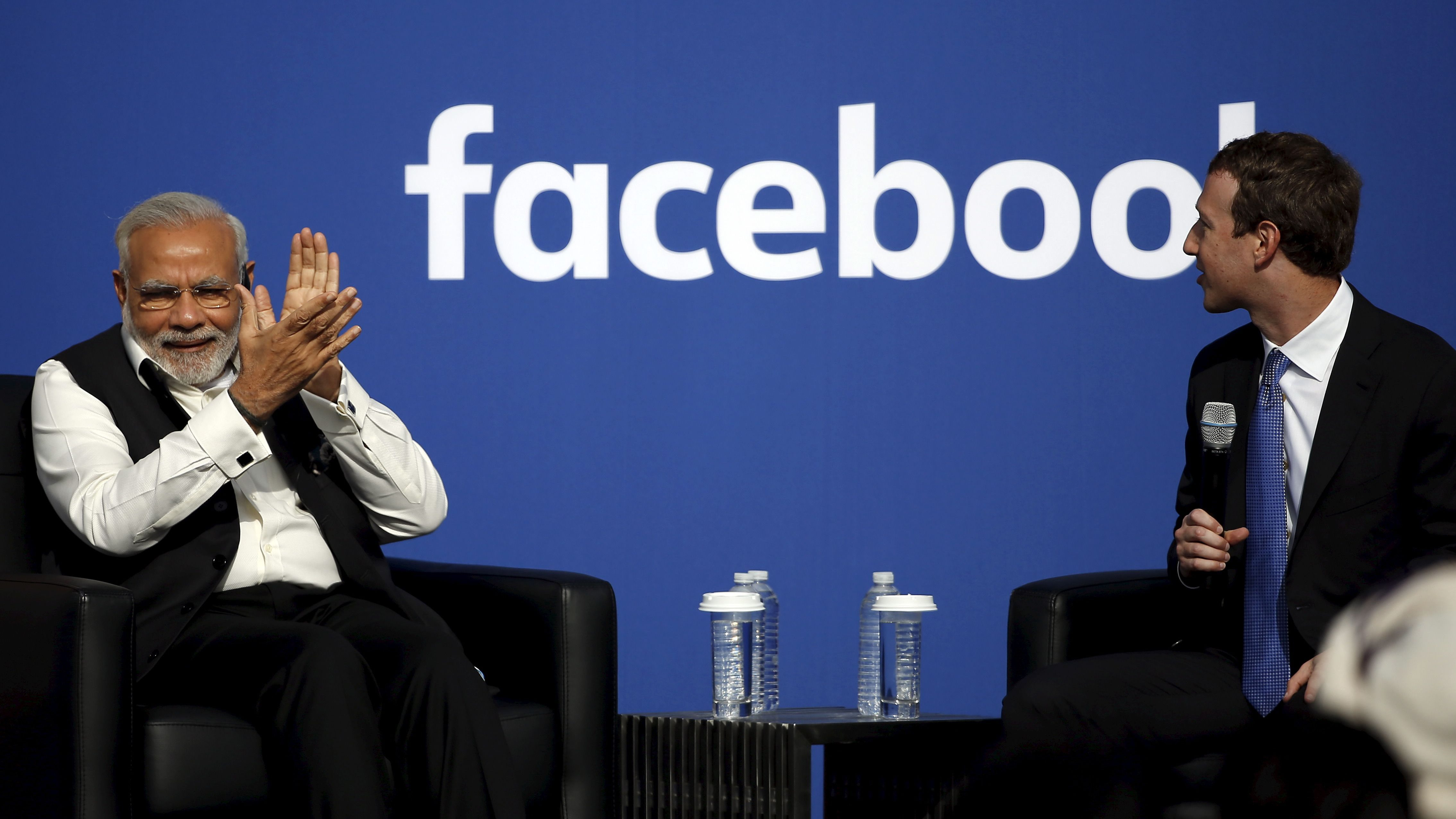 Indian Prime Minister Narendra Modi applauds as Facebook CEO Mark Zuckerberg speaks on stage during a town hall at Facebook's headquarters in Menlo Park, California September 27, 2015.