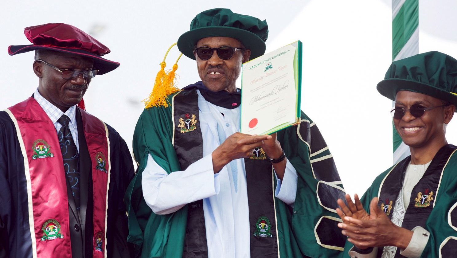 Nigeria's President Muhammadu Buhari receives a certificate after being conferred a doctorate during a graduation ceremony at Kaduna State University in Kaduna