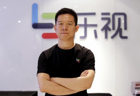 Jia Yueting, co-founder and head of Le Holdings Co Ltd, also known as LeEco and formerly as LeTV, poses for a photo in front of a logo of his company after a Reuters interview at LeEco headquarters in Beijing, China, picture taken April 22, 2016. To match Insight