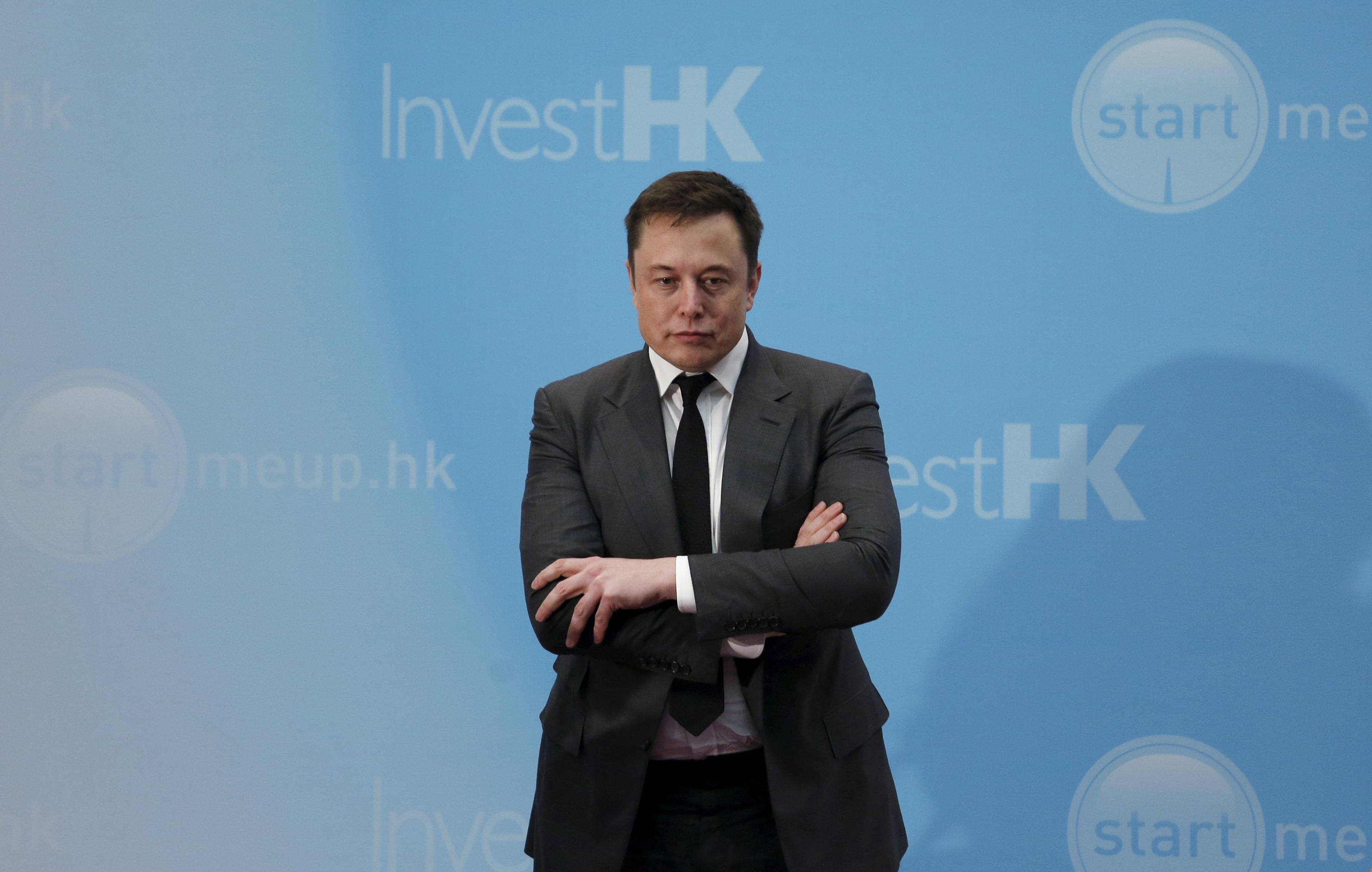 Tesla Chief Executive Elon Musk stands on the podium as he attends a forum on startups in Hong Kong, China January 26, 2016. REUTERS/Bobby Yip/File Photo - RTX2J8MS
