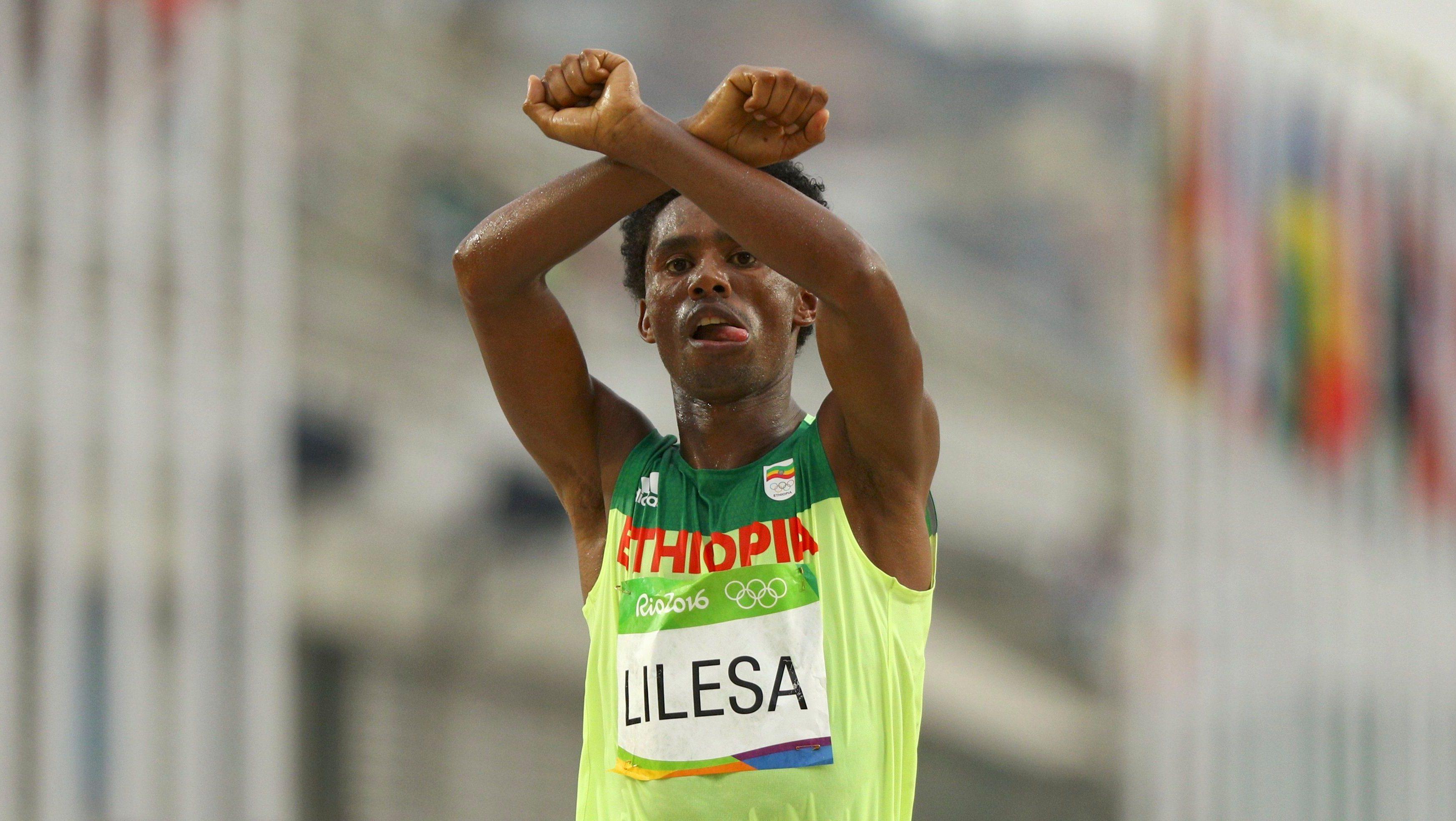 2016 Rio Olympics - Athletics - Final - Men's Marathon - Sambodromo - Rio de Janeiro, Brazil - 21/08/2016. Feyisa Lilesa (ETH) of Ethiopia celebrates.