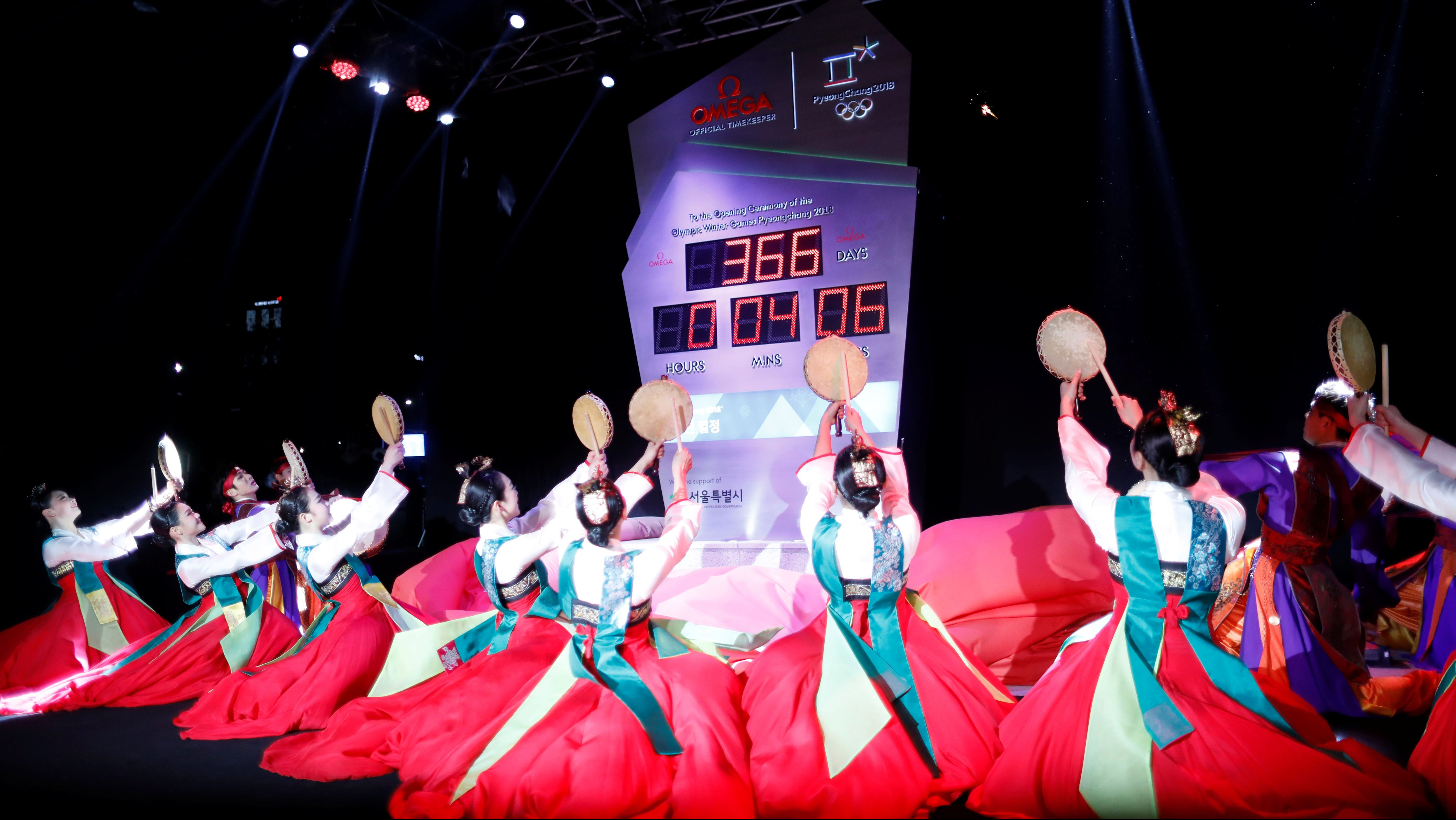 Women wearing Korean traditional costume Hanbok perform during an unveiling ceremony of the Olympic countdown clock to mark a year to the 2018 Pyeongchang Winter Olympic Games in Seoul, South Korea, February 8, 2017.   REUTERS/Kim Hong-Ji - RC190AA0E5D0