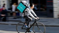 A cyclist rides a bicyle as he delivers food for Deliveroo, an example of the emergence of what is known as the 'gig economy', in Paris, France, April 7, 2017. Picture taken April 7, 2017.