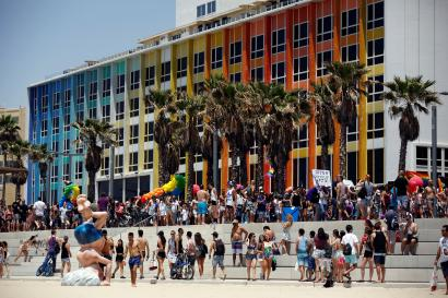 Revellers take part in a gay pride parade in Tel Aviv