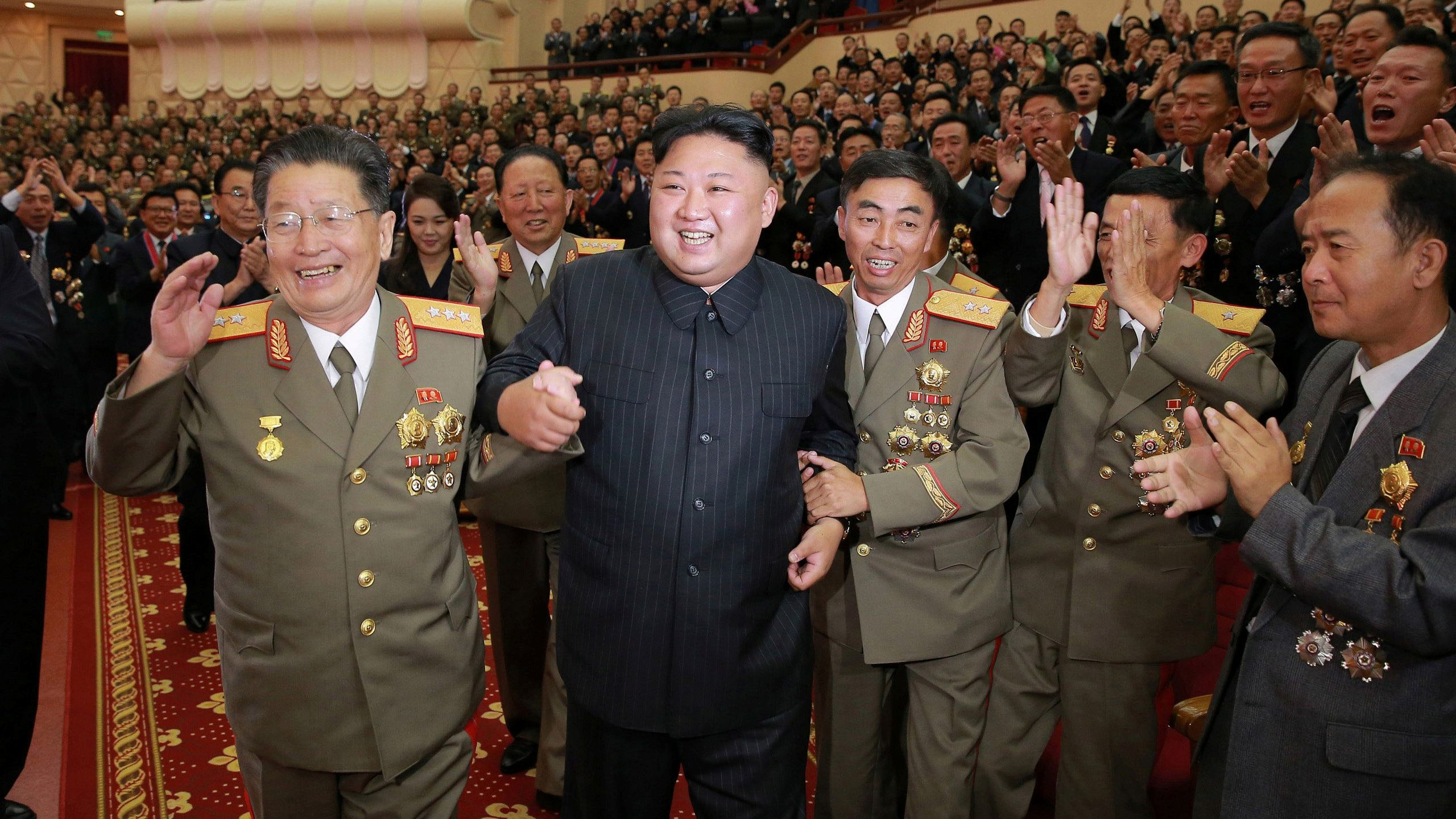 North Korean leader Kim Jong Un reacts during a celebration for nuclear scientists and engineers who contributed to a hydrogen bomb test, in this undated photo released by North Korea's Korean Central News Agency (KCNA) in Pyongyang on September 10, 2017.