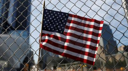 An American flag is seen left on a fence outside the National 9/11 Memorial and Museum during ceremonies marking the 16th anniversary of the September 11, 2001 attacks in New York