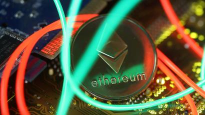 Representation of the Ethereum virtual currency standing on the PC motherboard are seen in this illustration picture
