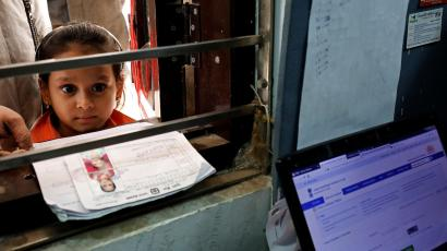 A girl waits for her turn to enrol for the Unique Identification database system, also known as Aadhaar, at a registration centre in New Delhi