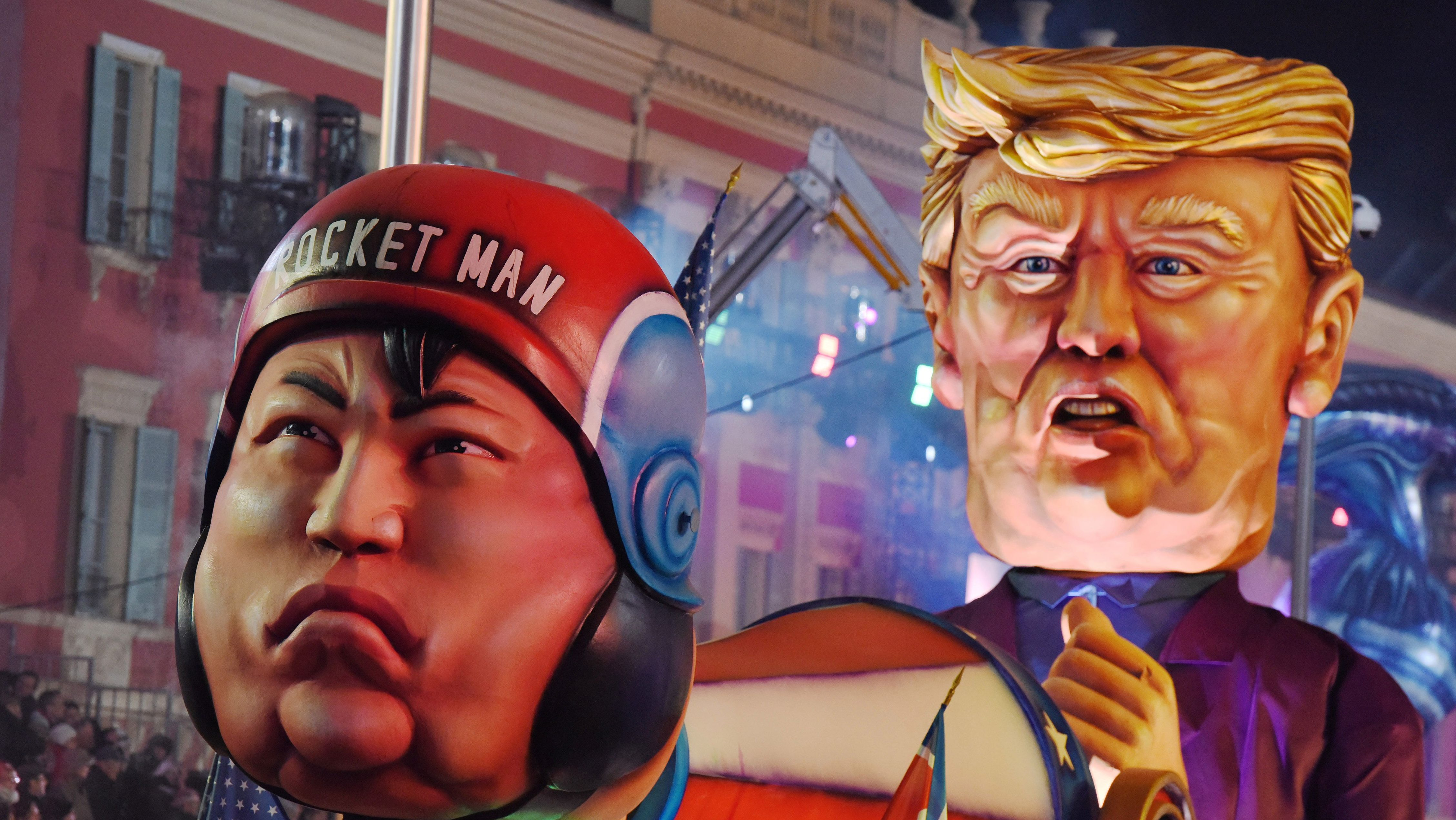 A float with effigies of North Korean leader Kim Jong Un and U.S. President Donald Trump is paraded through the crowd during the 134th Carnival parade in Nice, France February 20, 2018. REUTERS/Jean-Pierre Amet - RC1A29B94640
