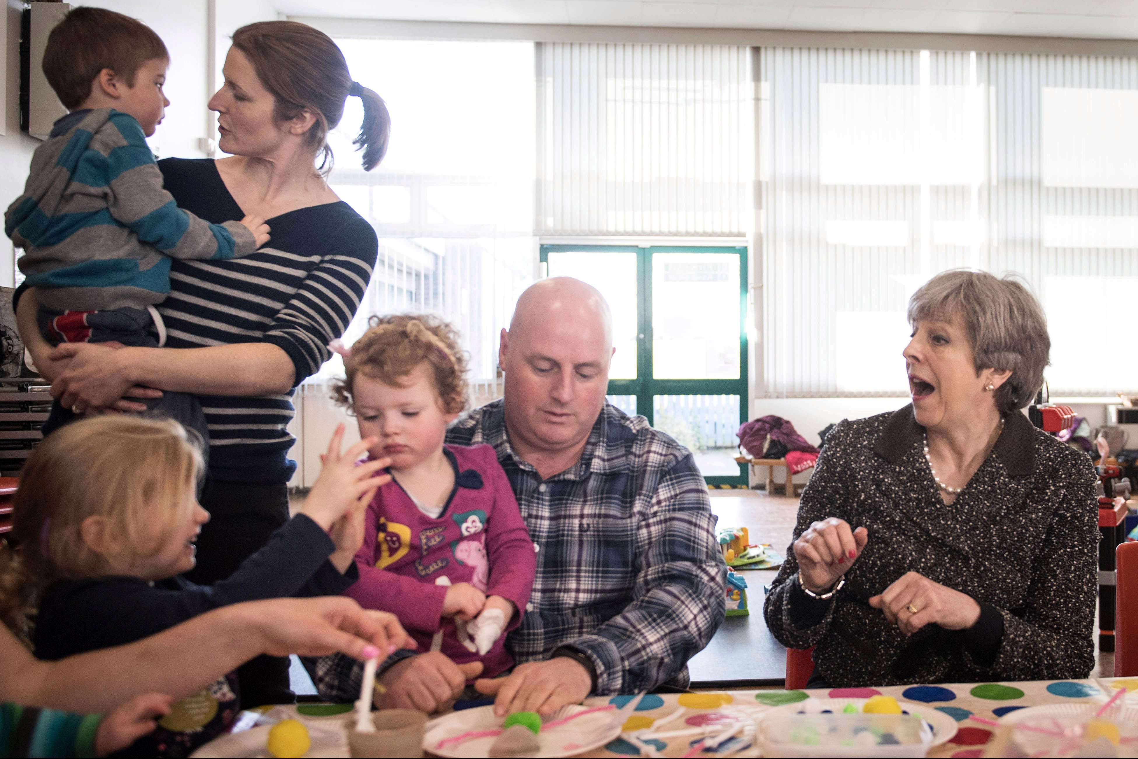 Britain's Prime Minister Theresa May meets a local parent and toddler group at St Andrew's Heddon-on-the-Wall, CofE Primary School in Newcastle, March 29, 2018.  Stefan Rousseau/Pool via Reuters - RC196377FD30