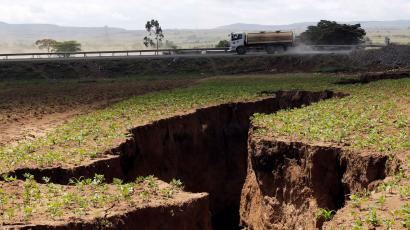 A tanker drives near a chasm suspected to have been caused by a heavy downpour along an underground fault-line near the Rift Valley town of Mai-Mahiu, Kenya March 28, 2018. Picture taken March 28, 2018.