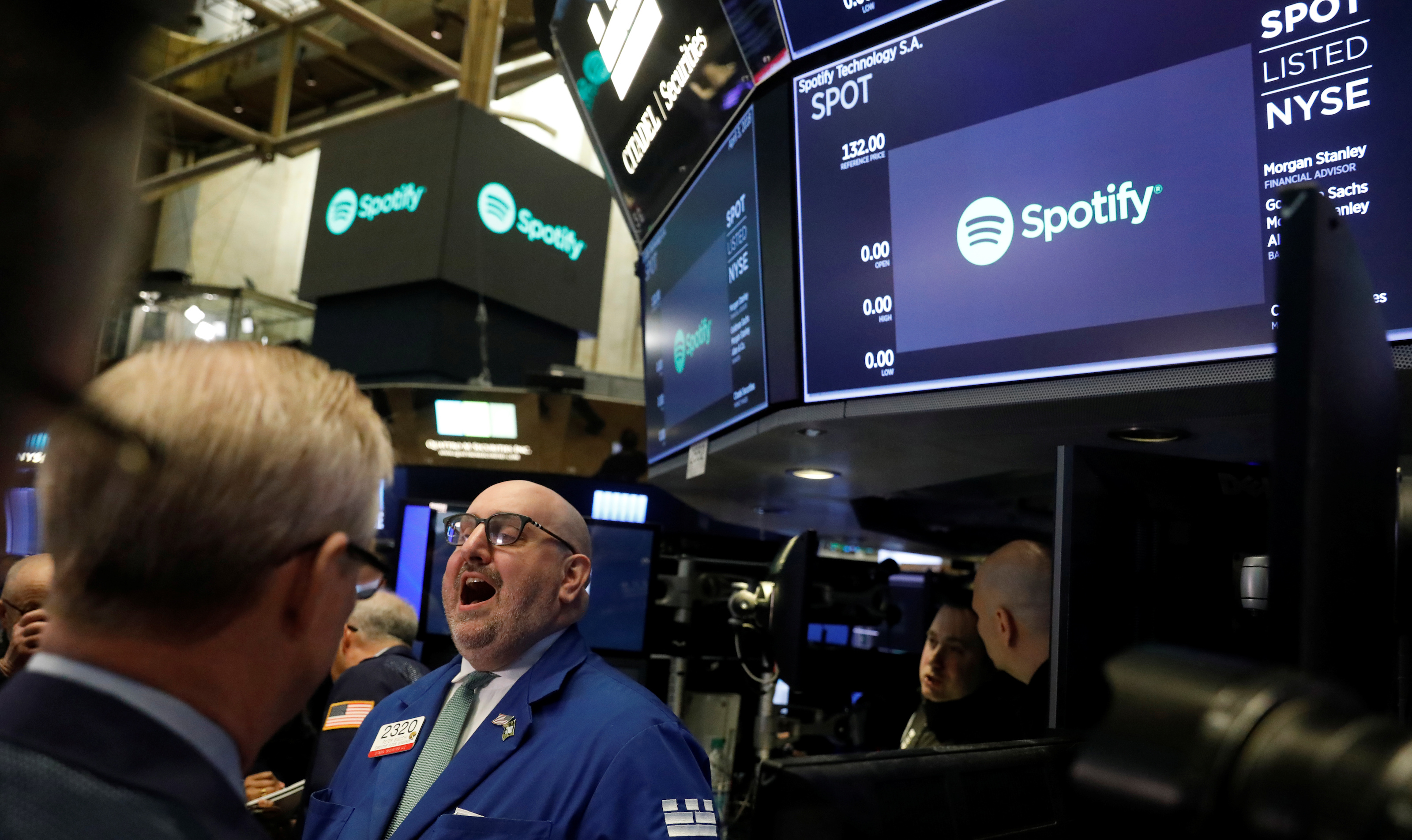 A price update is given on shares of Spotify before the company's direct listing on the floor of the New York Stock Exchange in New York, U.S., April 3, 2018. REUTERS/Lucas Jackson - RC178CA0BBE0