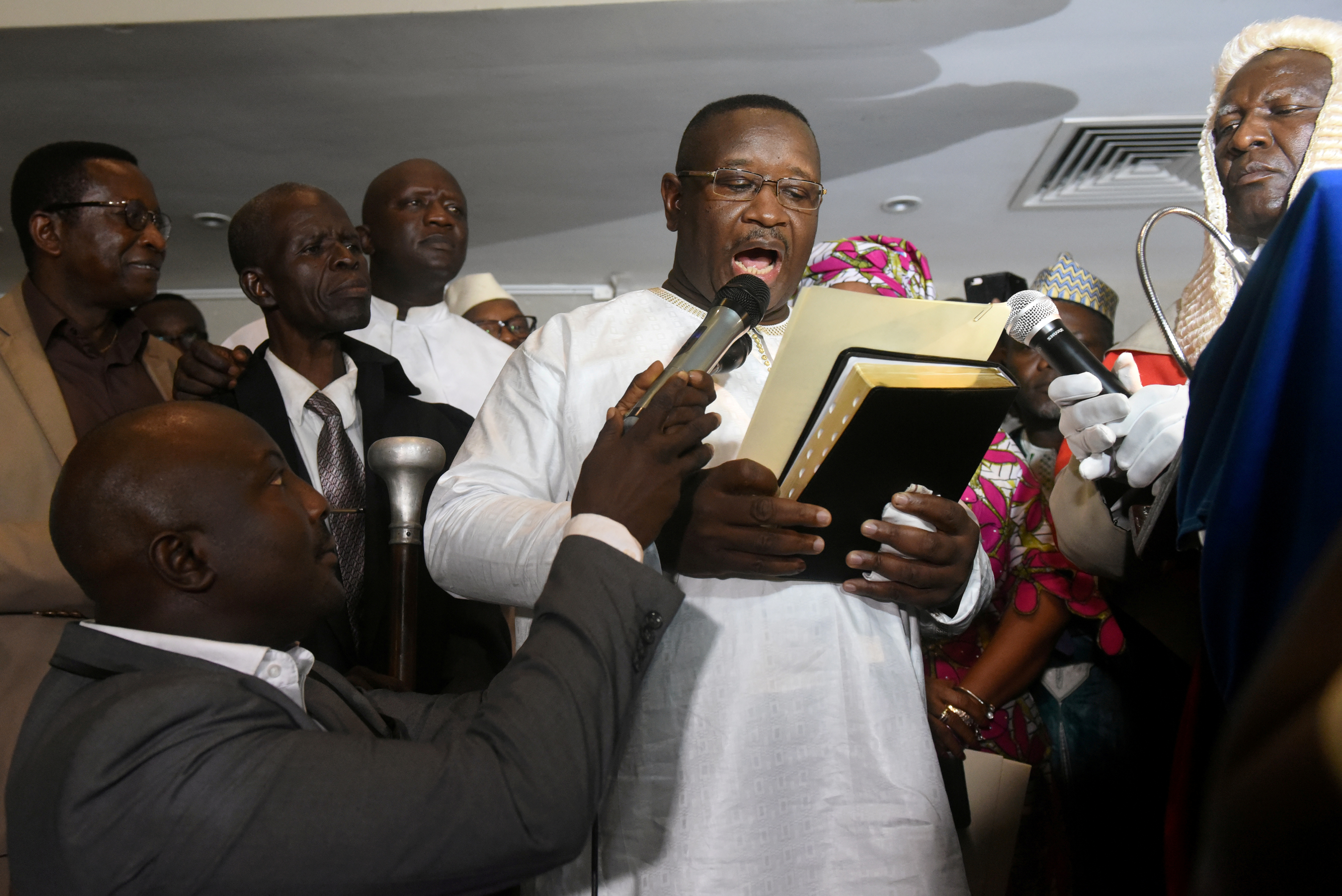 Opposition candidate and former military junta leader Julius Maada Bio takes his oath as Sierra Leone's new president in Freetown, Sierra Leone April 4, 2018.     TPX IMAGES OF THE DAY - RC127FB50D10